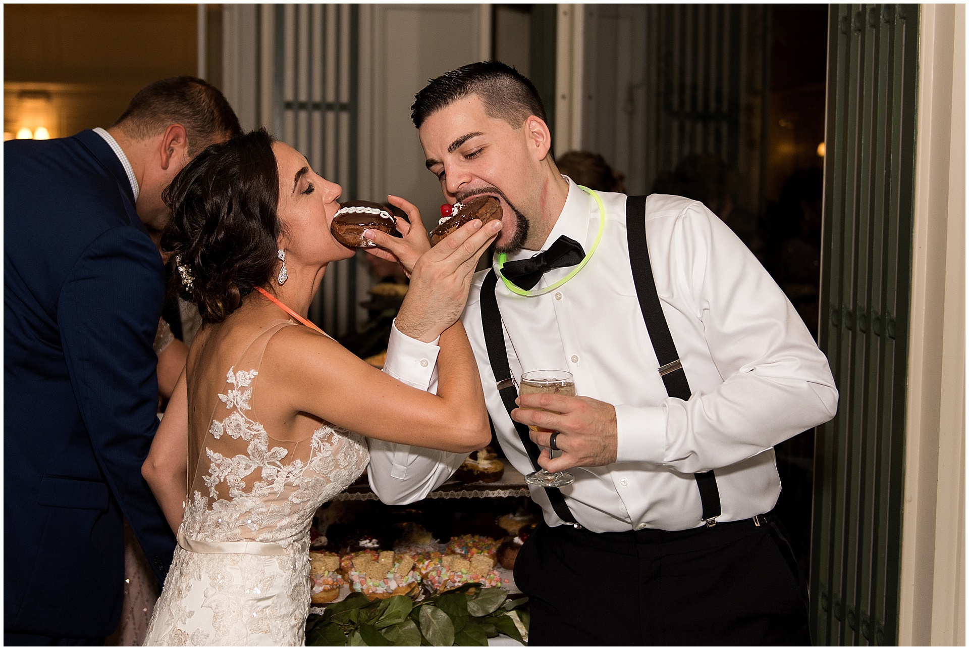 bride and groom eating donuts Eolia Mansion Harkness Park wedding photography