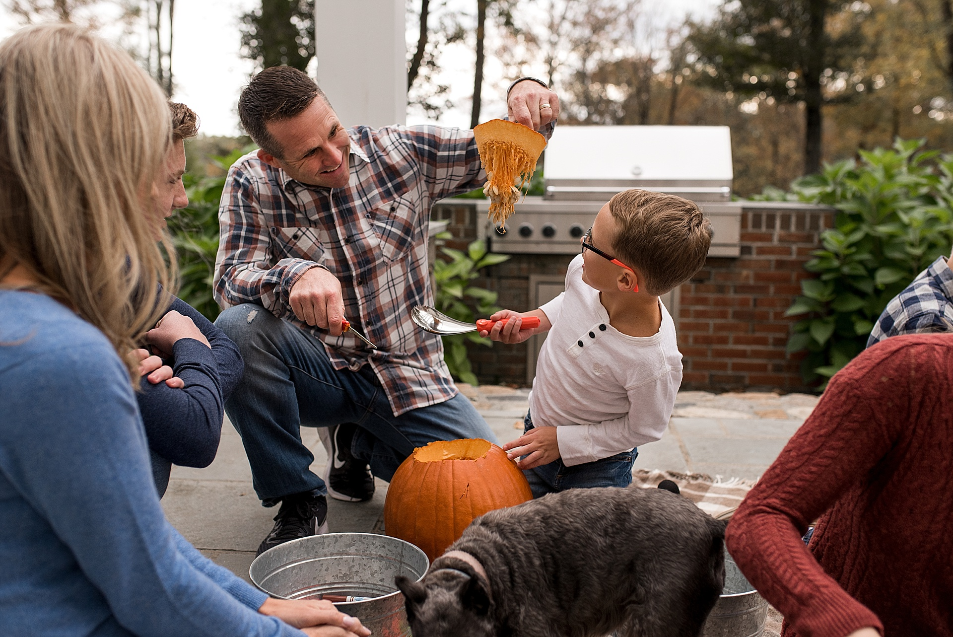 father and son carving pumpkins. New Hartford, Connecticut family photographer.