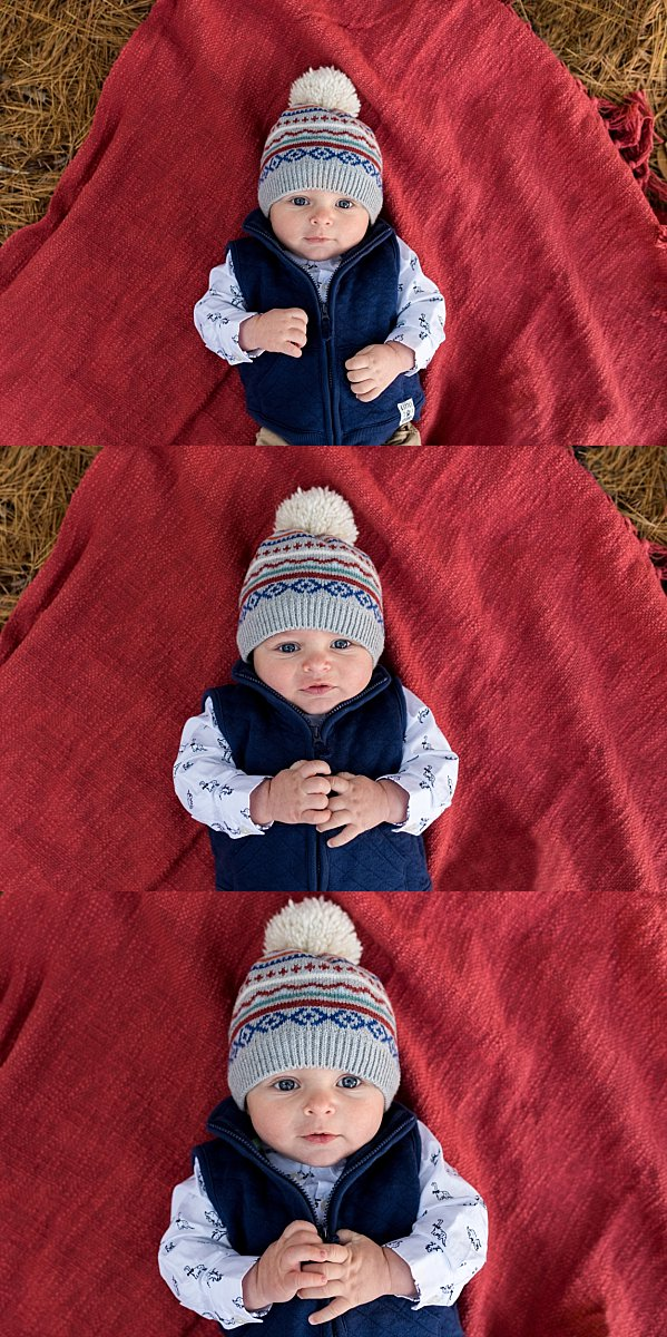 Family Photographer in CT capturing baby boy laying on a red blanket while wearing a winter hat.