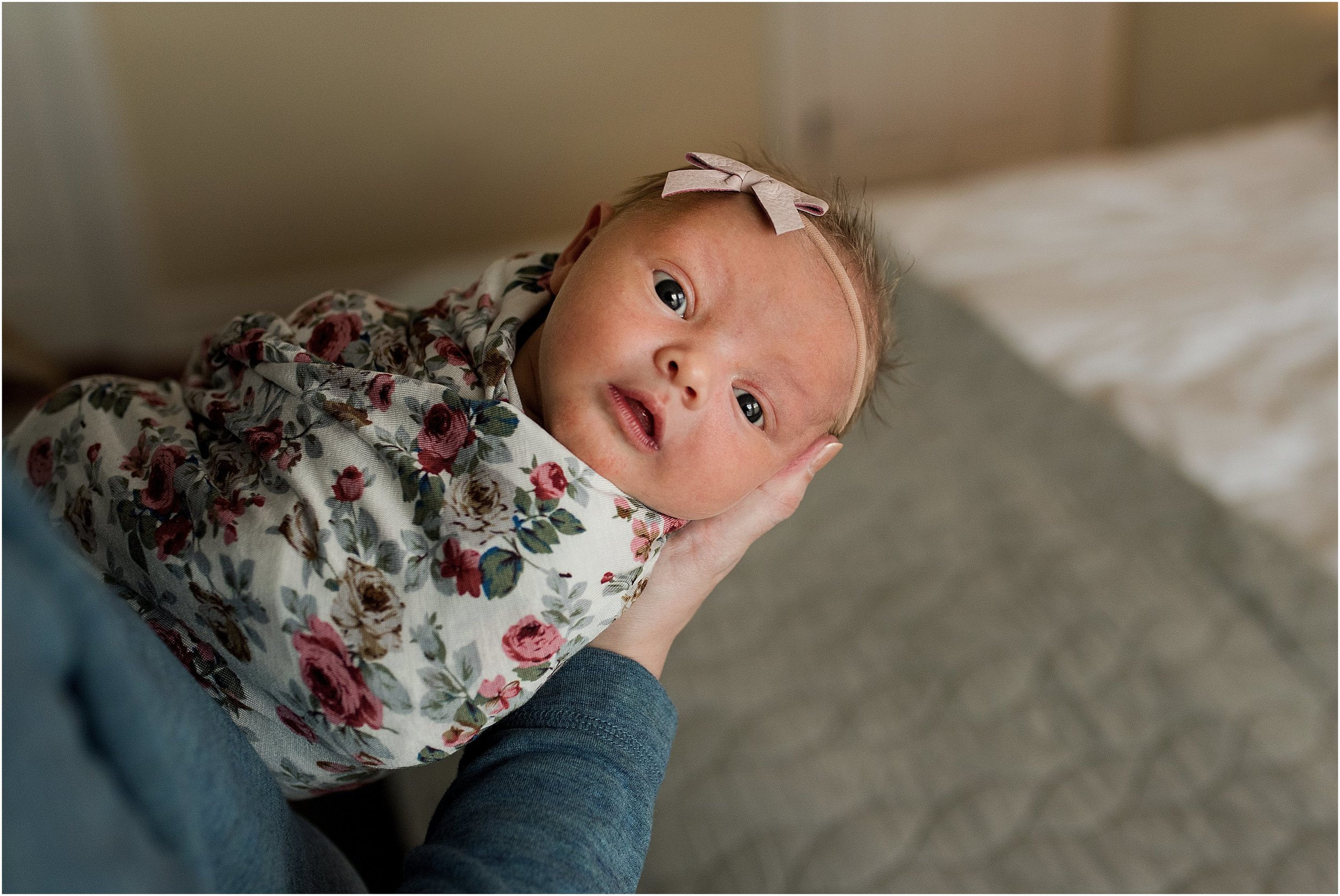 Newborn baby girl during an in home newborn photography session in CT