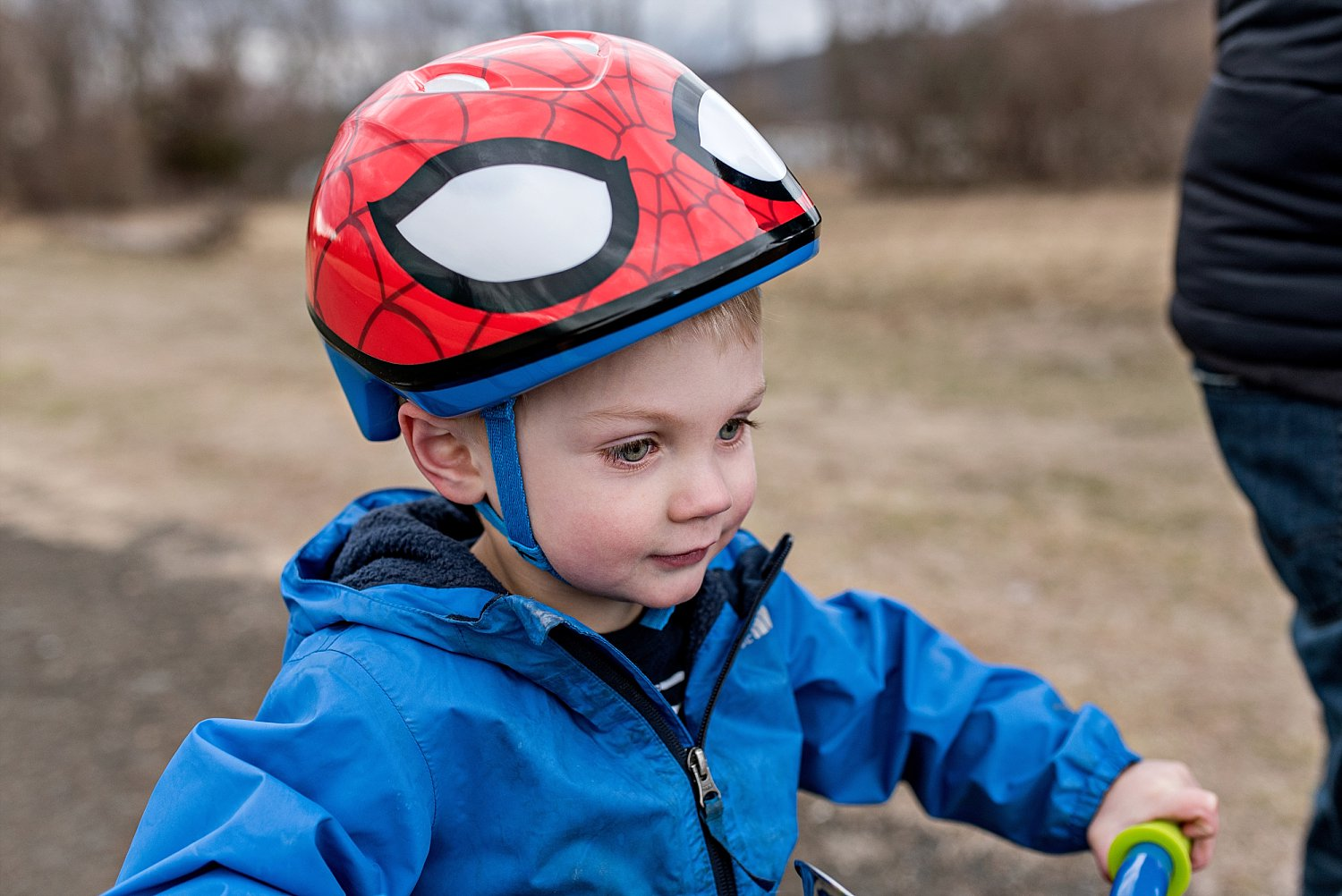 connecticut professional family photos. toddler boy with spider man helmet