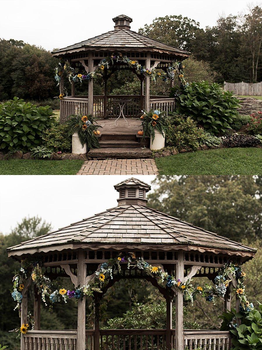 gazebo decorated in floral garland at wood acres farm wedding