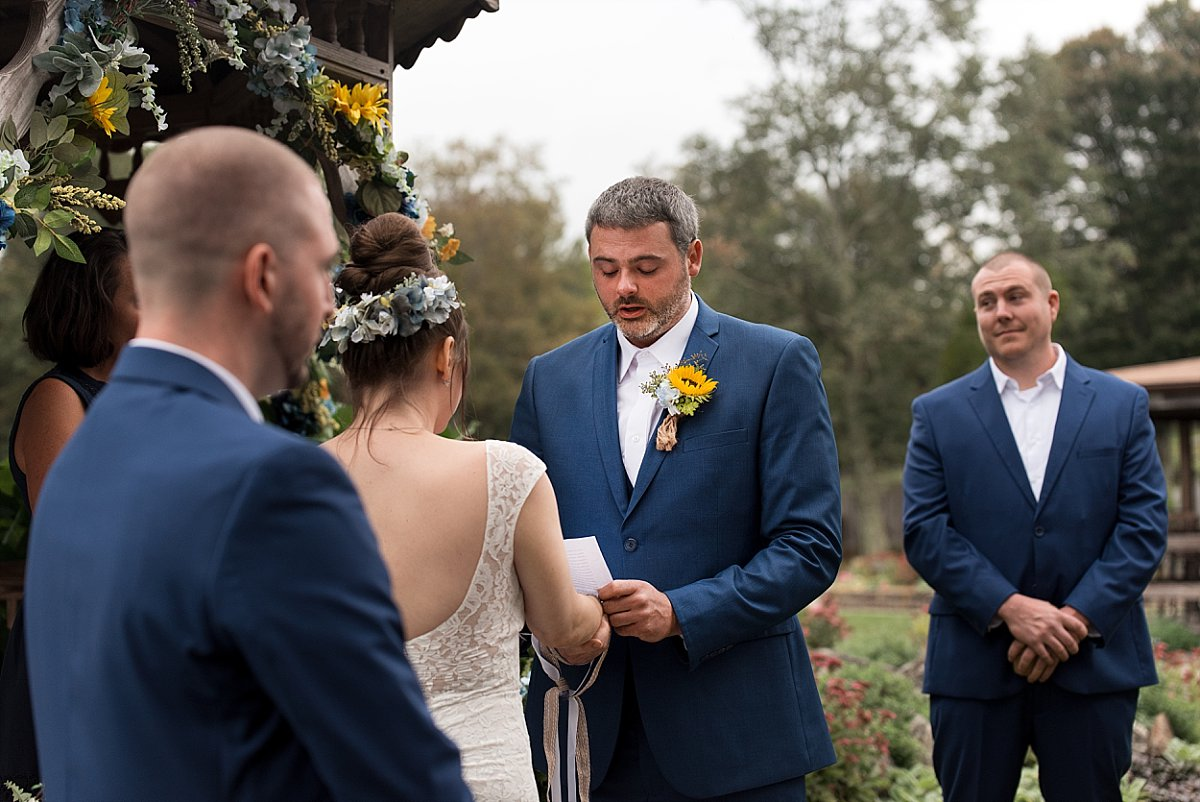 Groom reading wedding vows at wood acres farm connecticut wedding photography