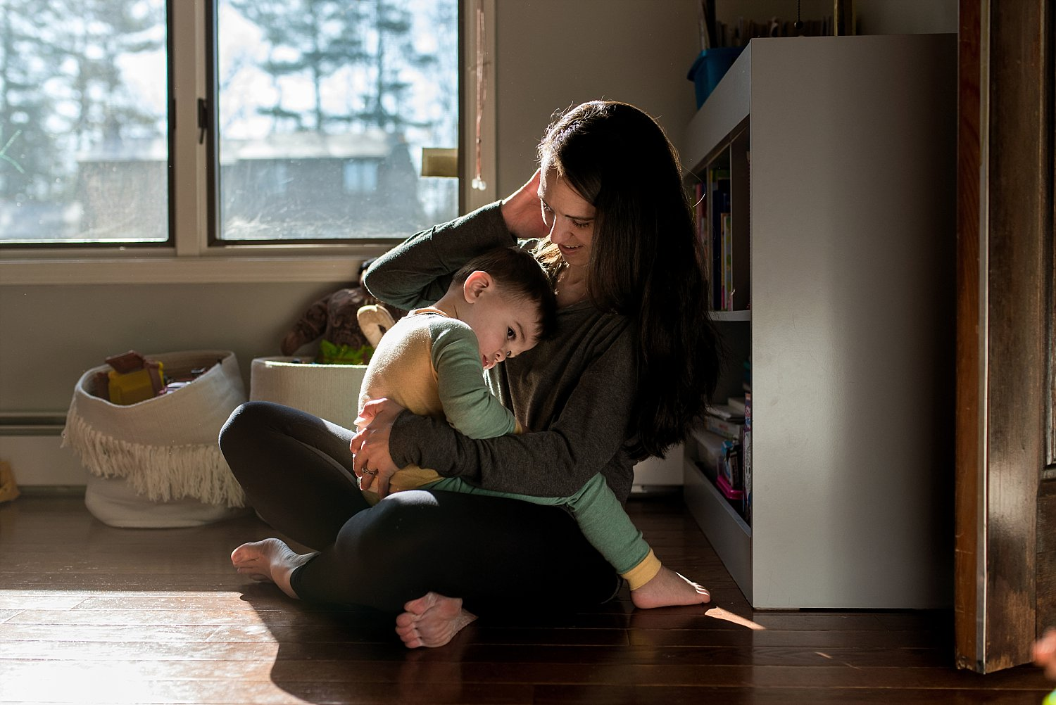 mother snuggling son during CT family photography