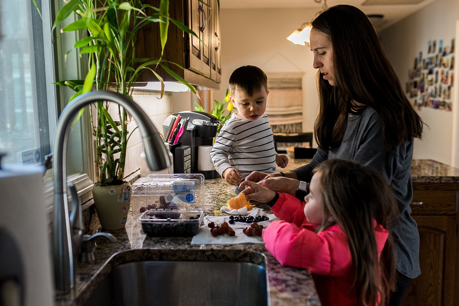children helping mom wash fruits for a snack. Connecticut children photography.