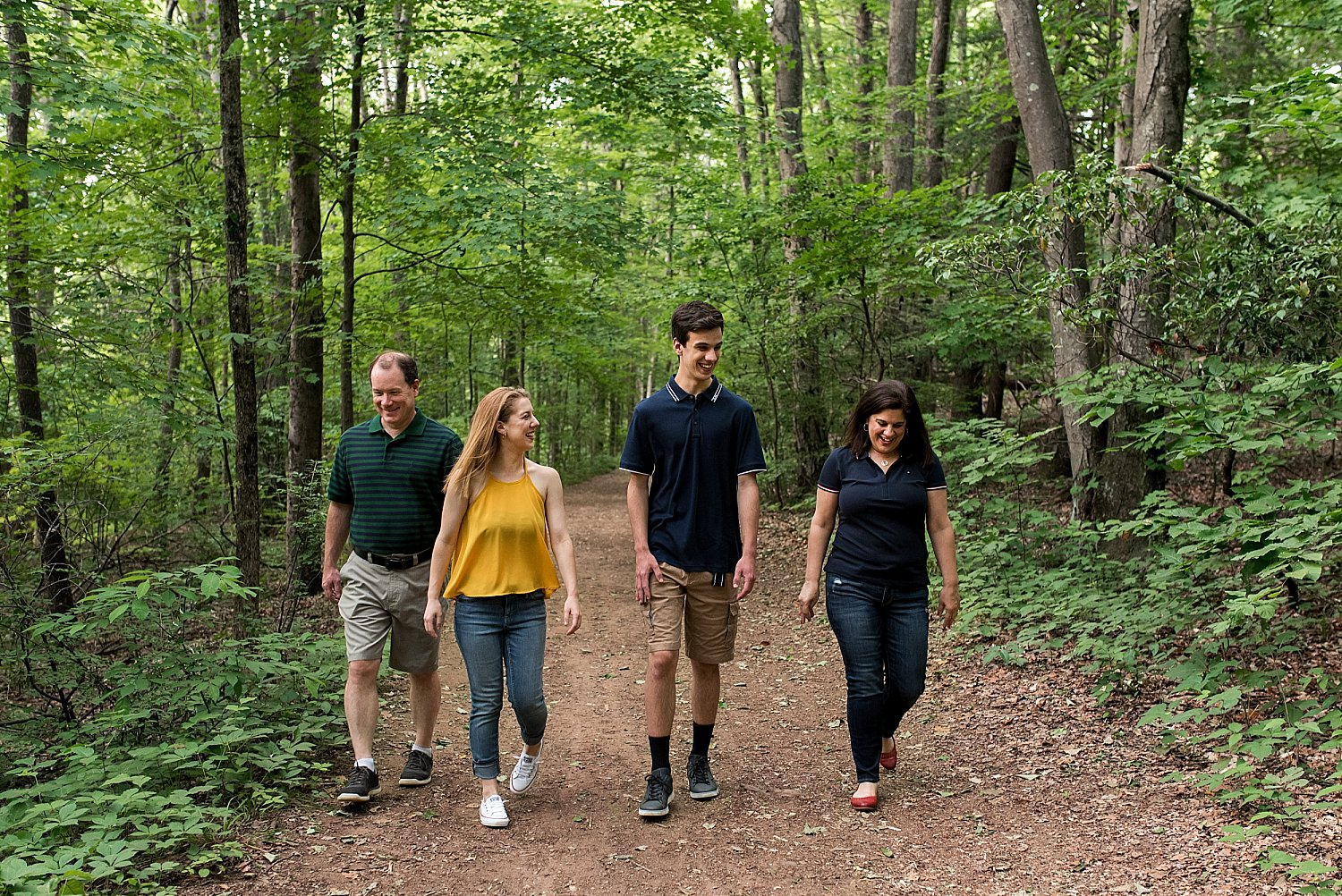 lifestyle family photography connecticut. family with older children hiking in woods.