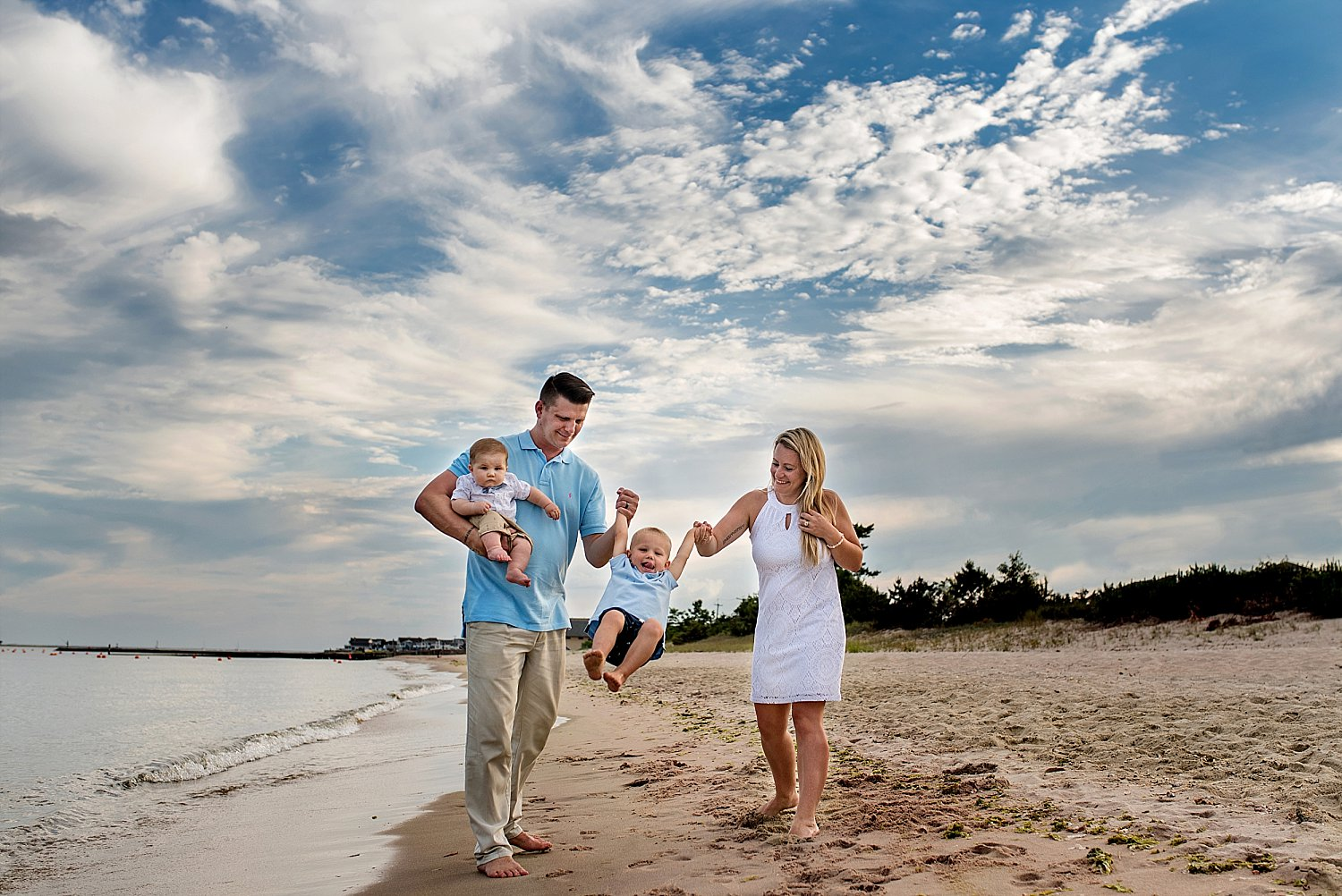 candid family photography at the beach in westbrook, connecticut