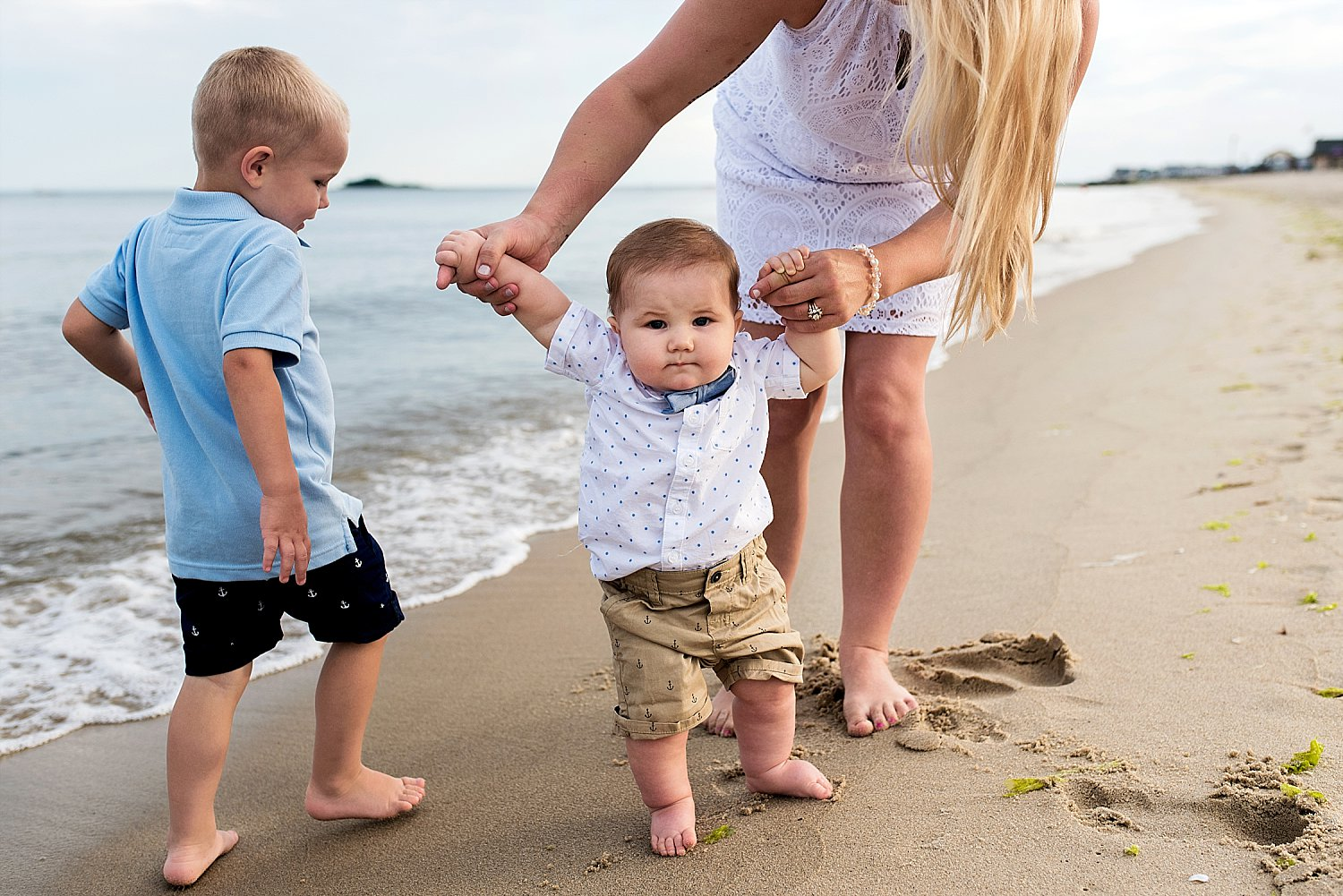 CT baby photographer. Infant boy at the beach with his mom during connecticut family photography.