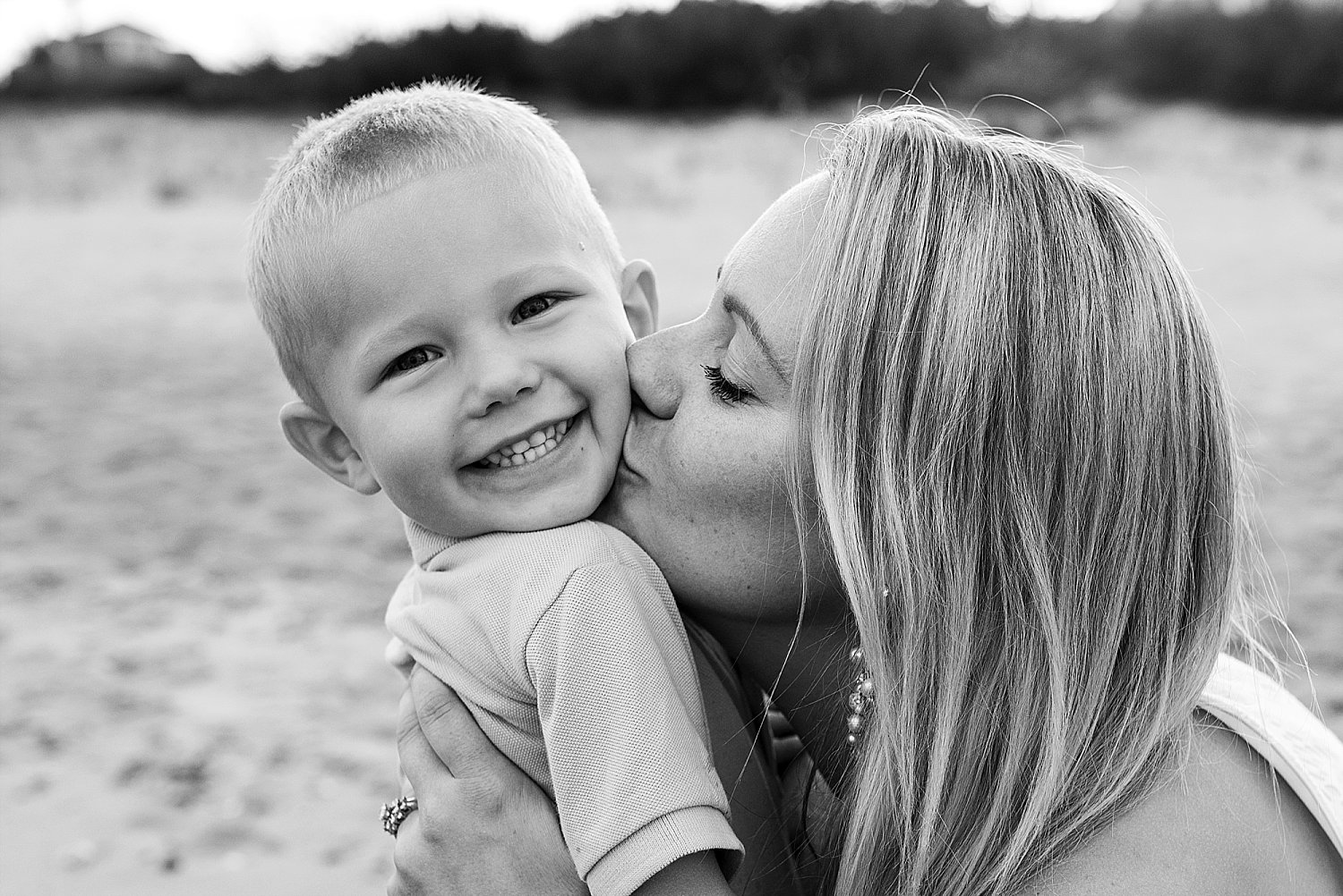 CT family photographer, mother kissing son during connecticut family photography.
