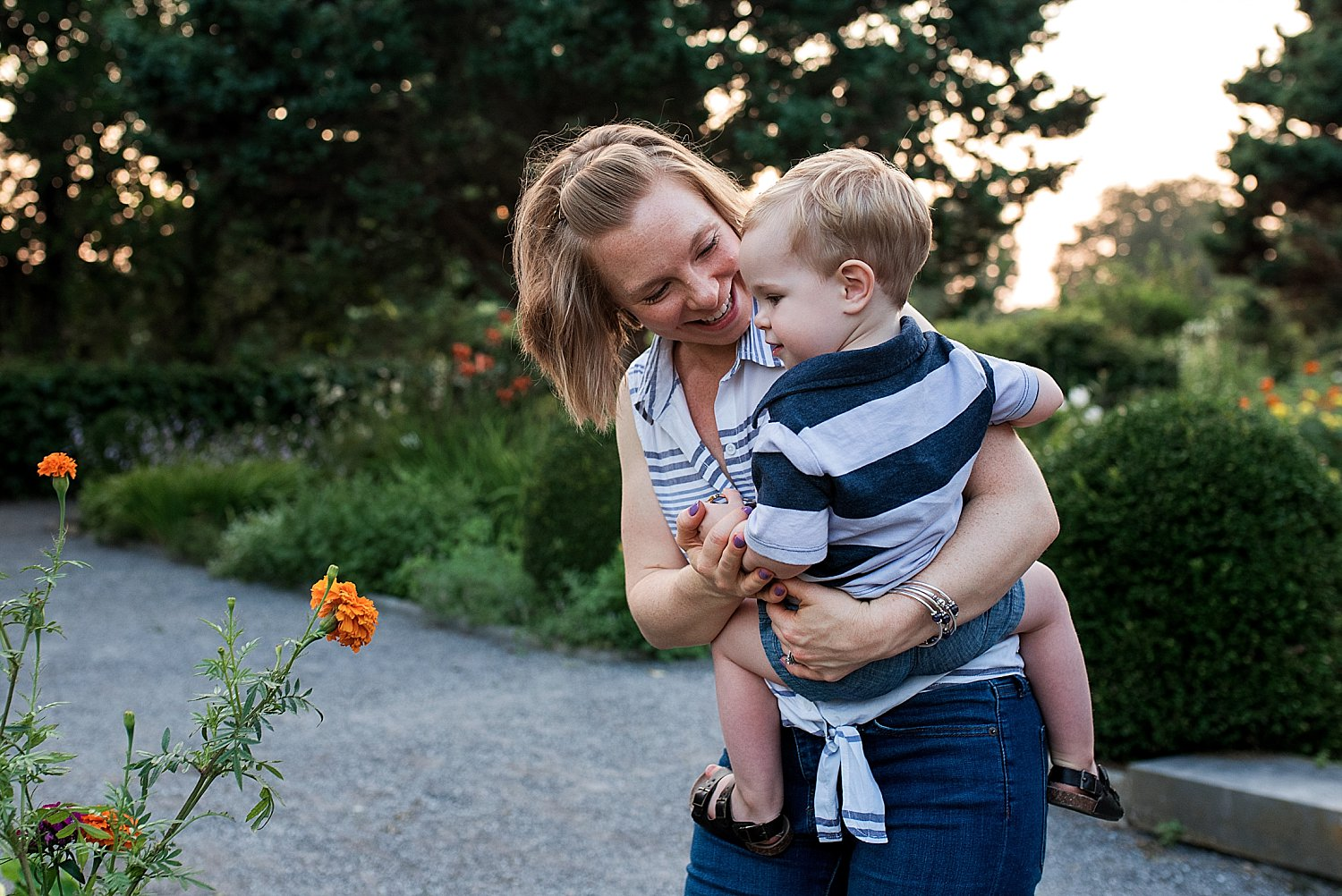 Mother holding toddler son in garden at Harkness Memorial Park in Waterford, CT