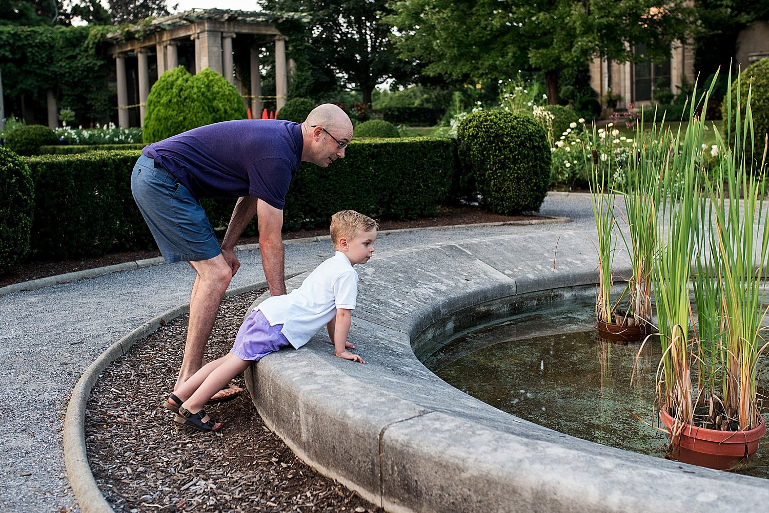 Father and son looking at pond during CT family photography