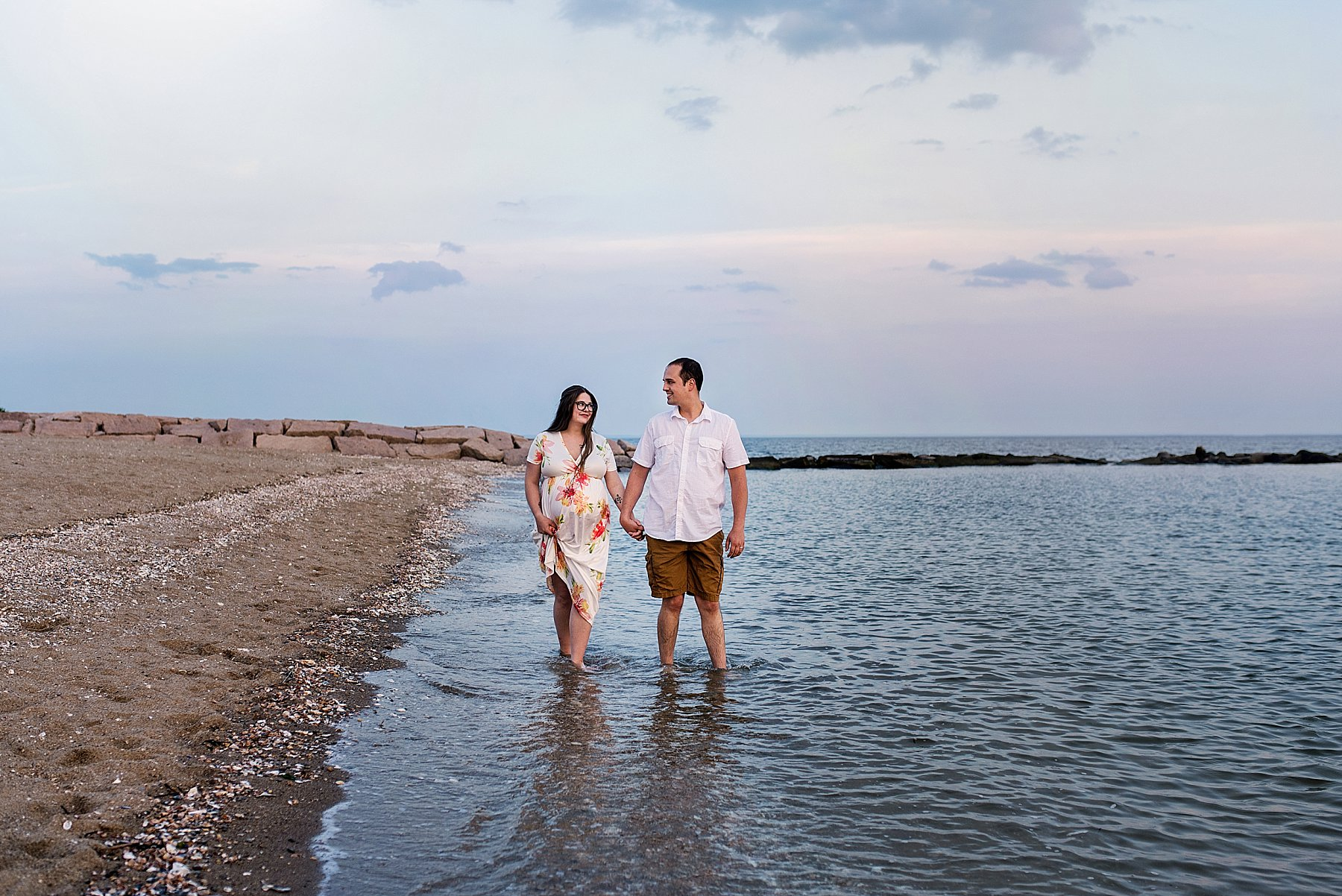 ct shoreline photographer. husband and wife expecting first baby