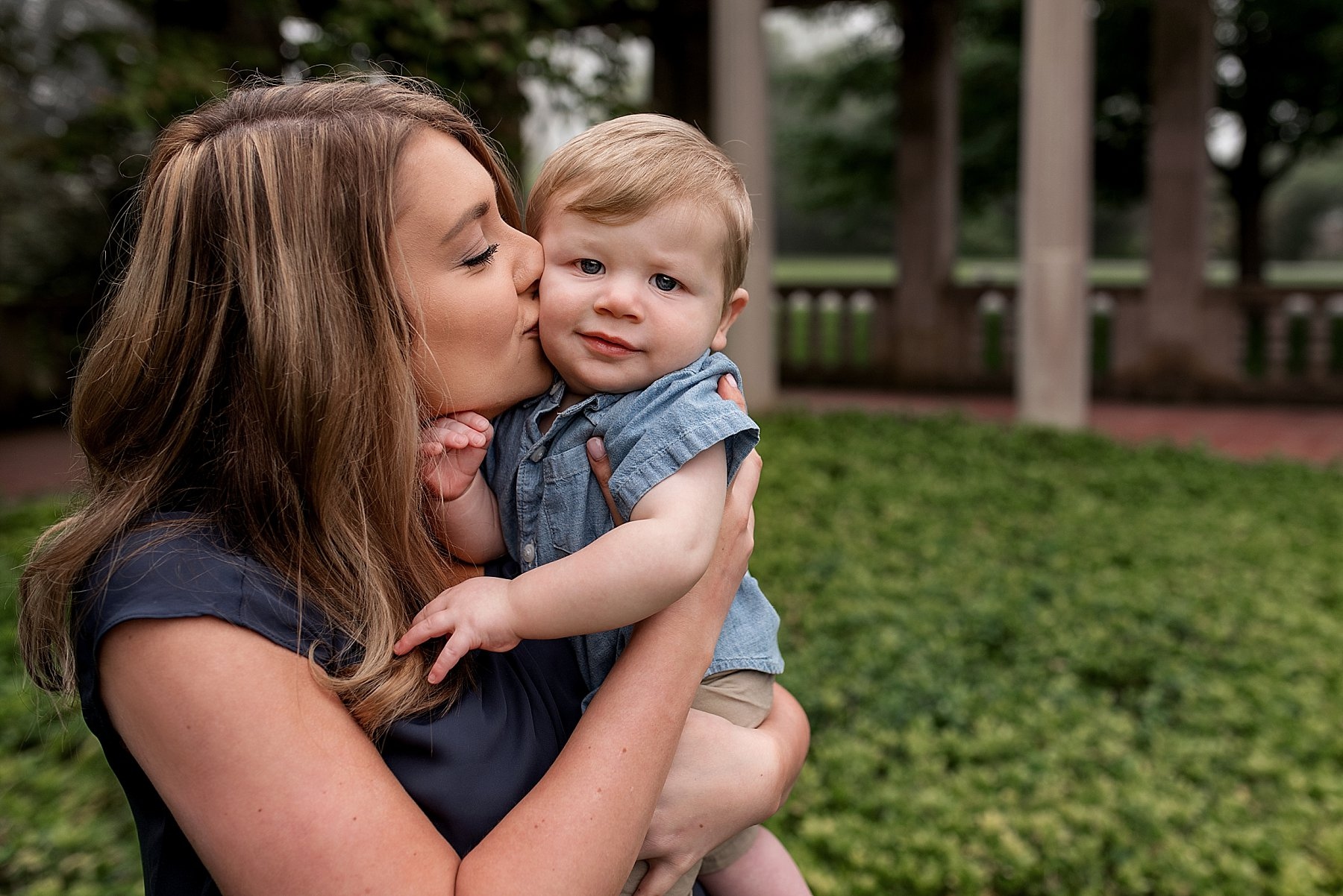 Connecticut family photographer. Mother kissing infant's cheek