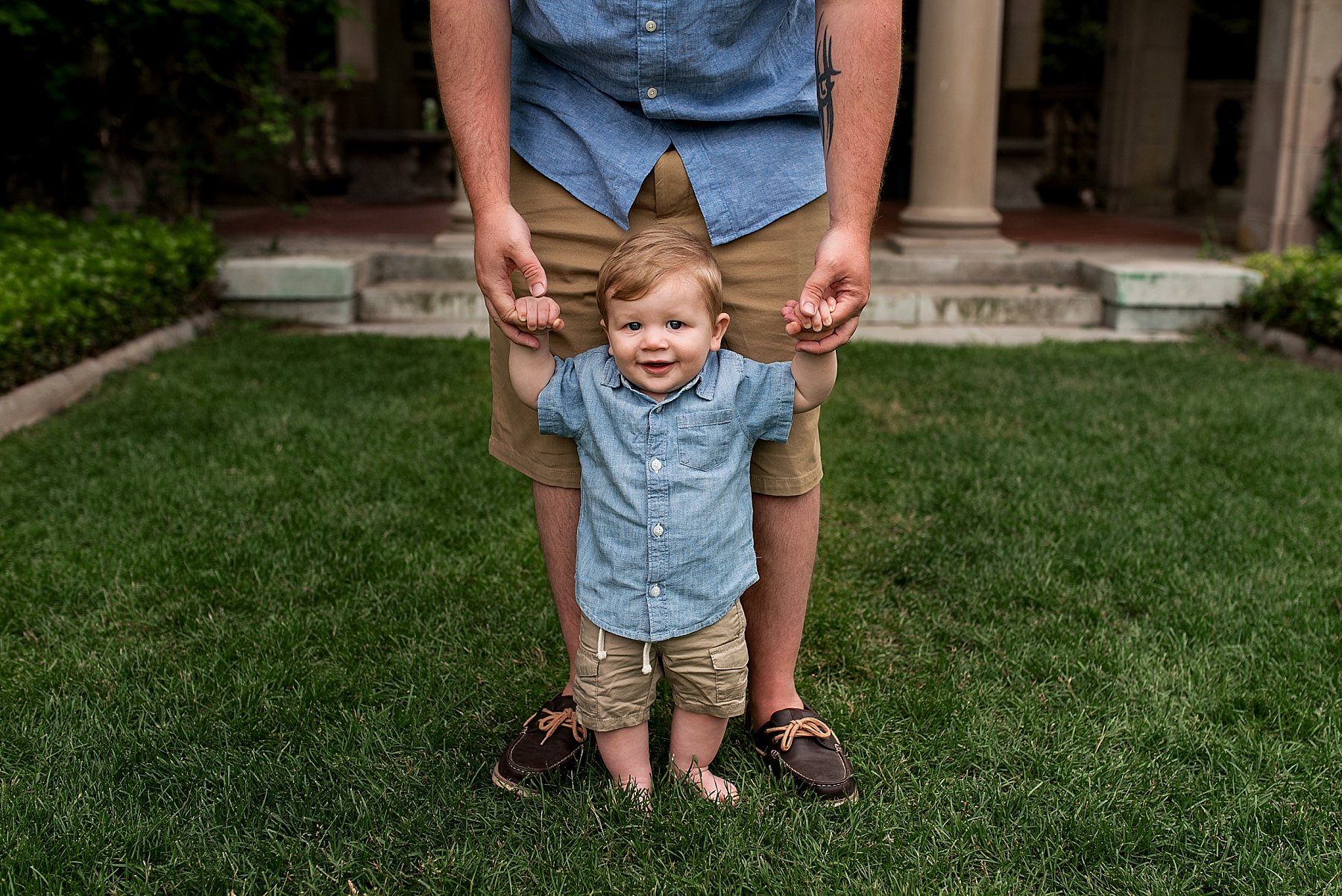 Baby holding dad's hands at CT family photo session