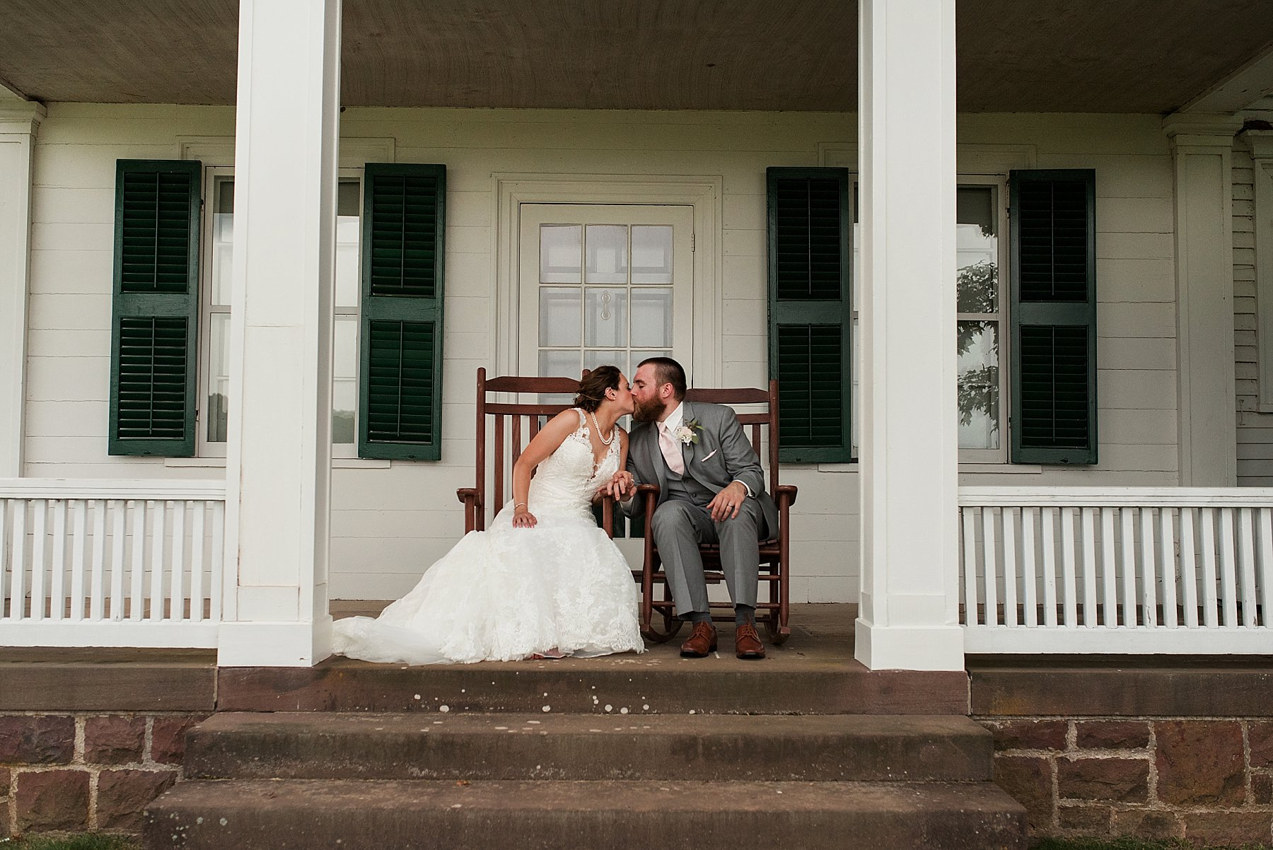bride and groom sitting on porch at hillstead museum venue