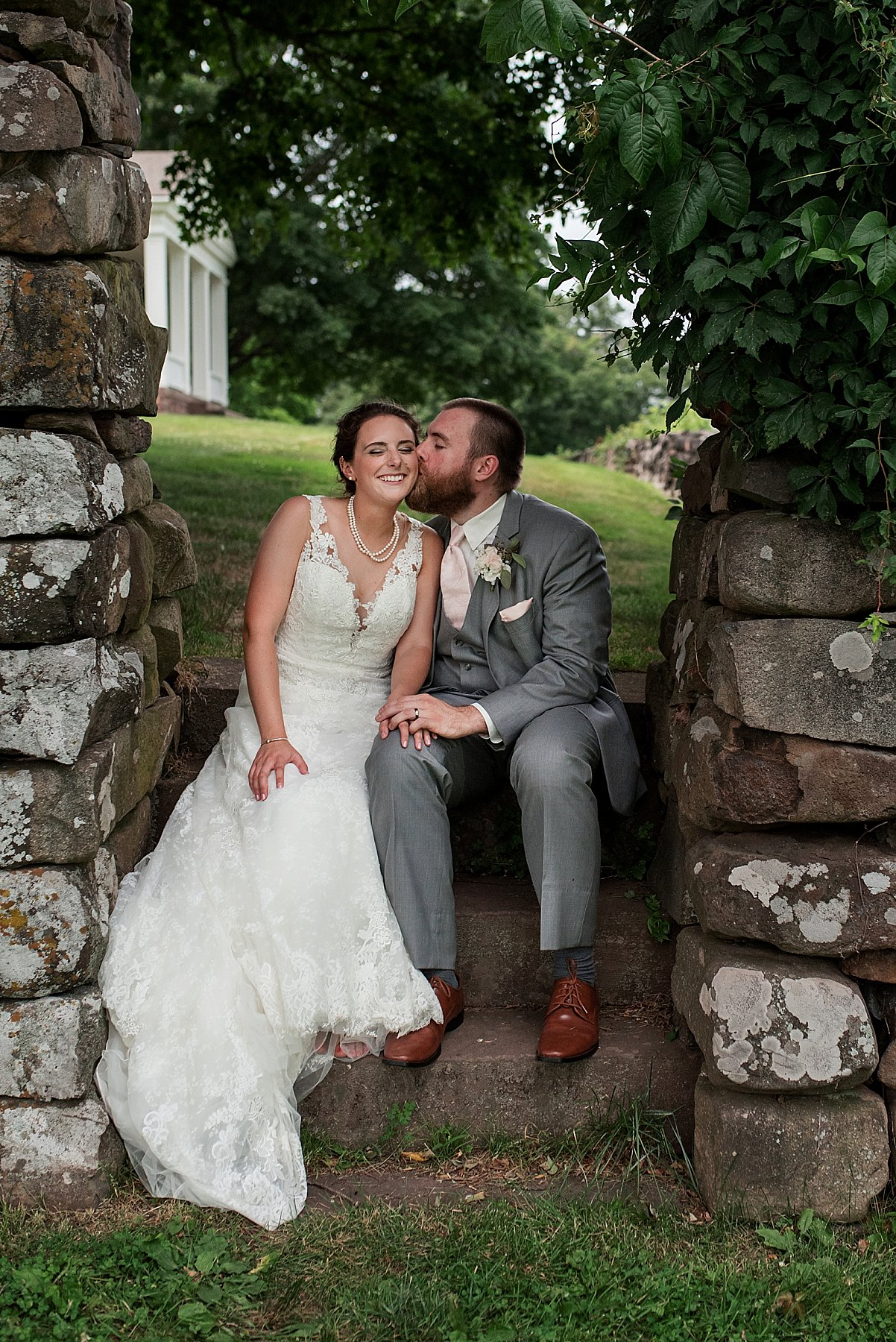 bride and groom in garden at the hillstead museum venue