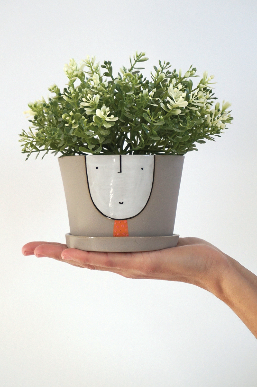 Planter guy & saucer $90