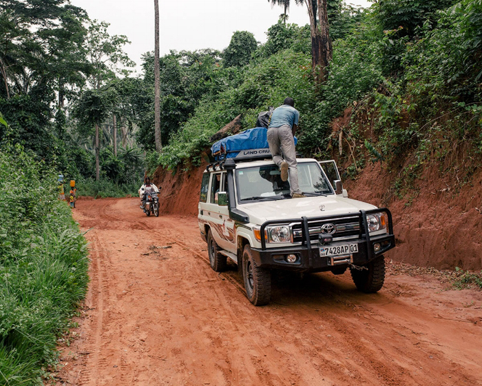 Our driver checking the gear during one of my assignments in the Democratic Republic of Congo.
