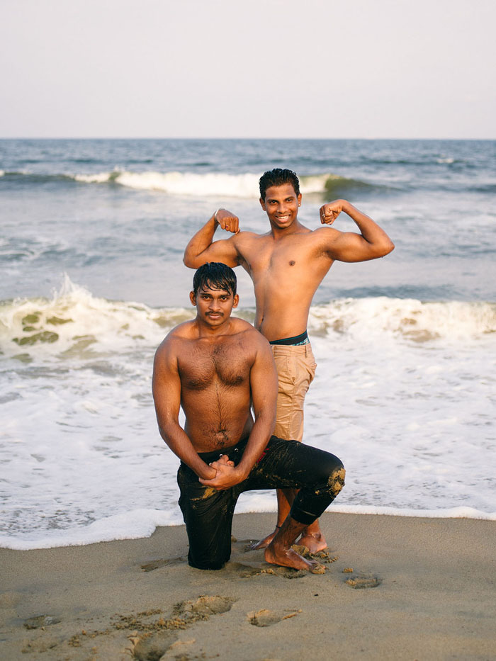Two guys showing off.