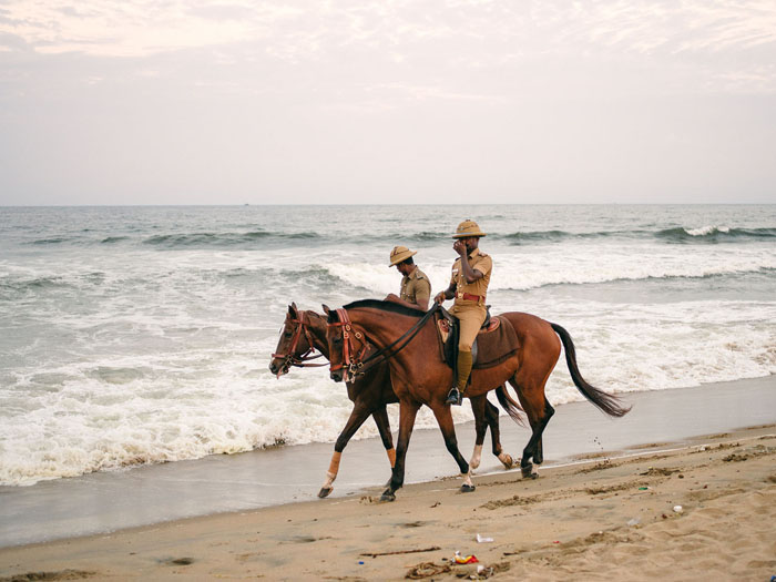 Mounted police patrolling the shoreline.