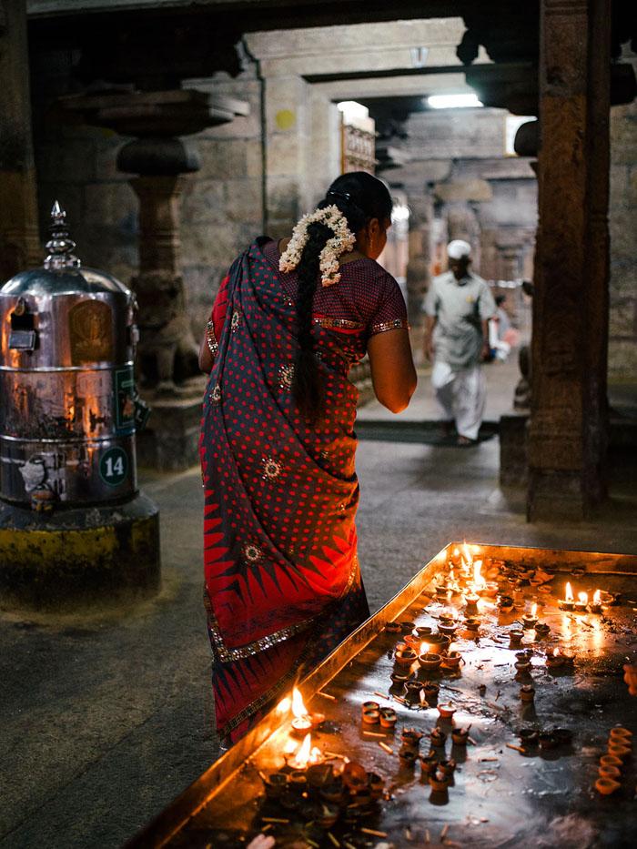 Woman making offerings.