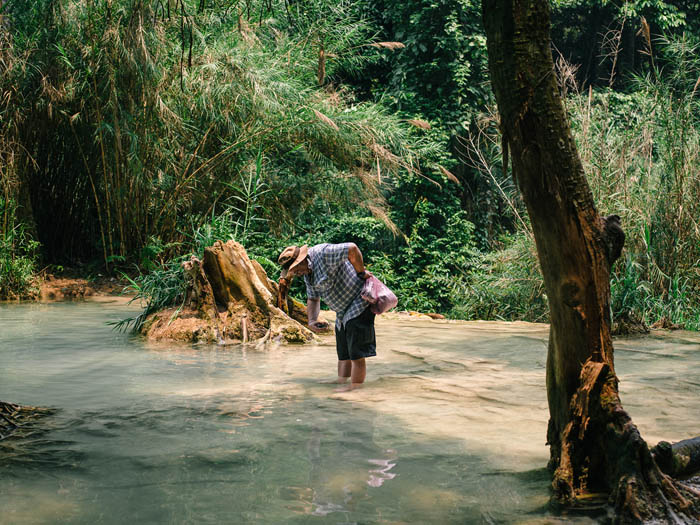 Not sure what he was trying to do. Kuang Si Waterfalls. Luang Prabang, Laos.
