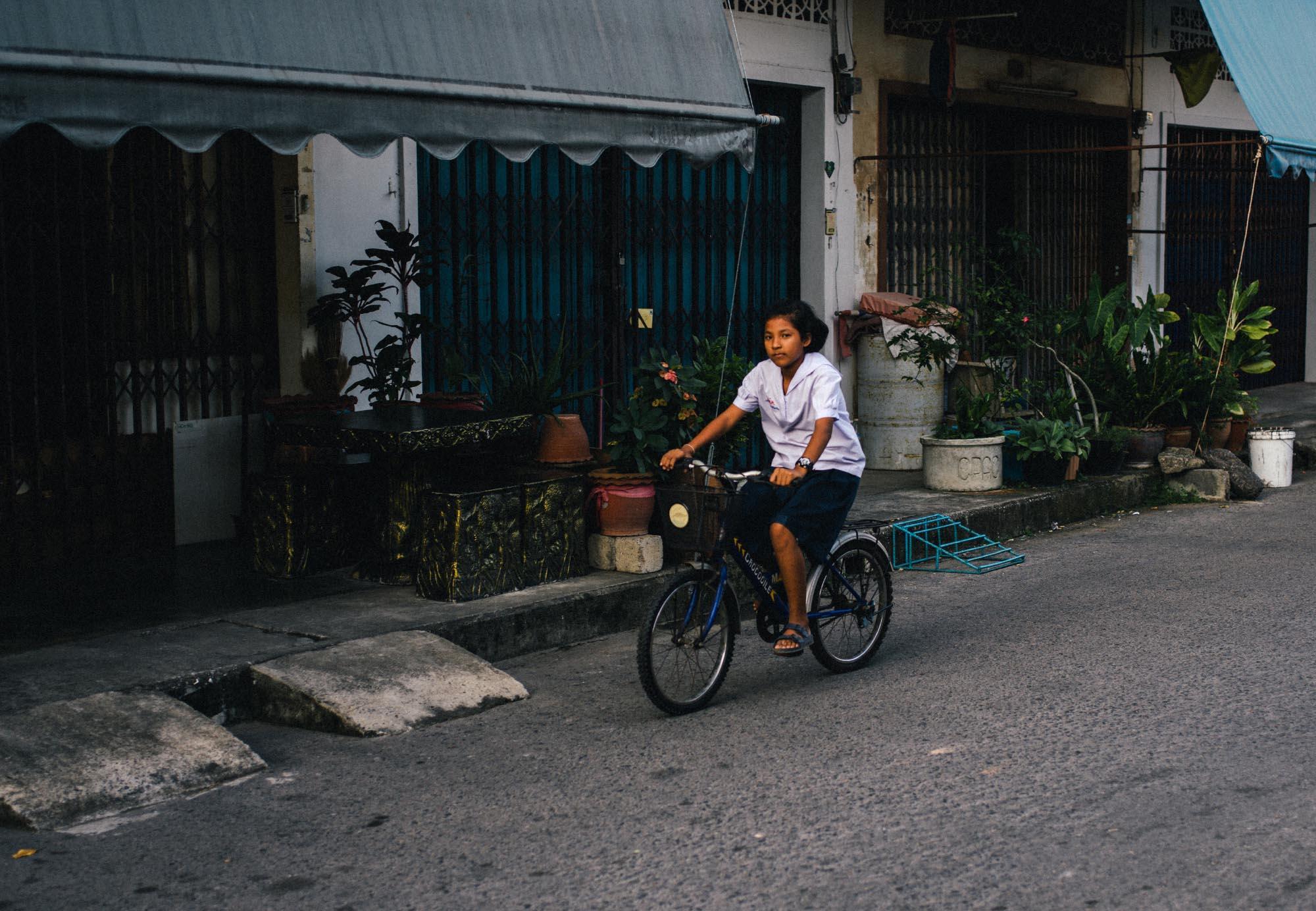 Girl riding bike.