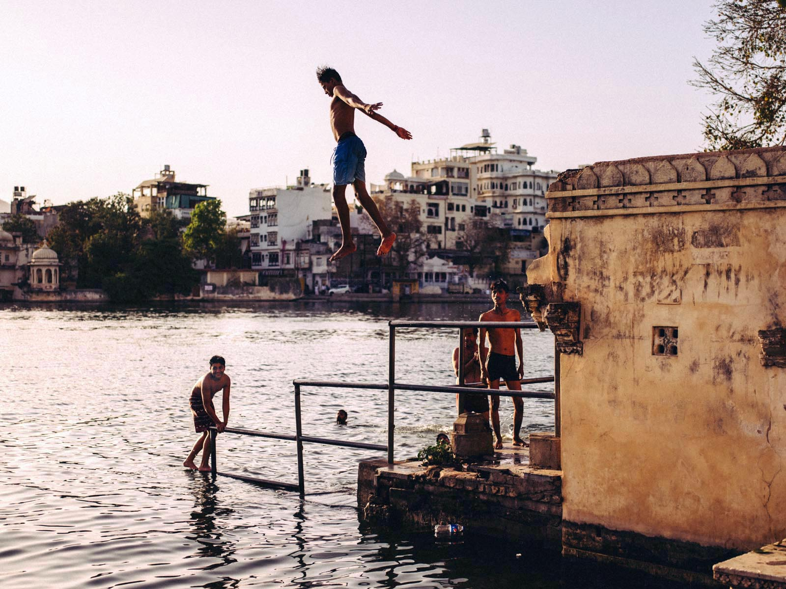 Boys playing in the river in Udaipur.