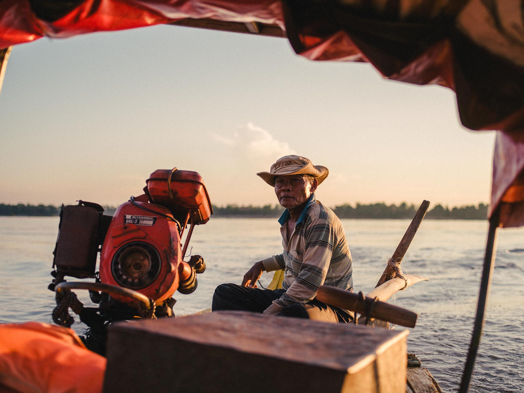 Dolphin spotting on the Mekong River. One of our favorite experiences in Cambodia...