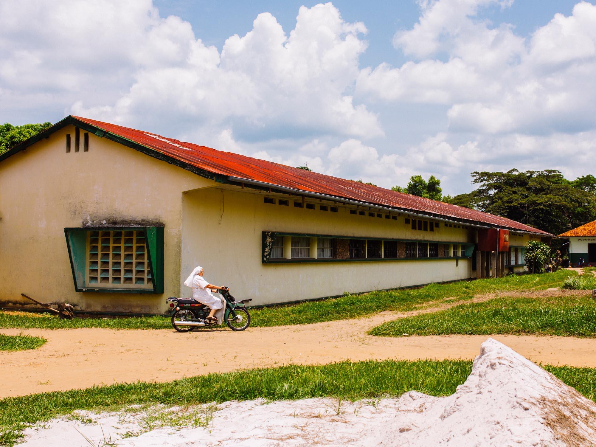 Bright sun at noon. A nun in Mosango hospital, Democratic Republic of Congo.