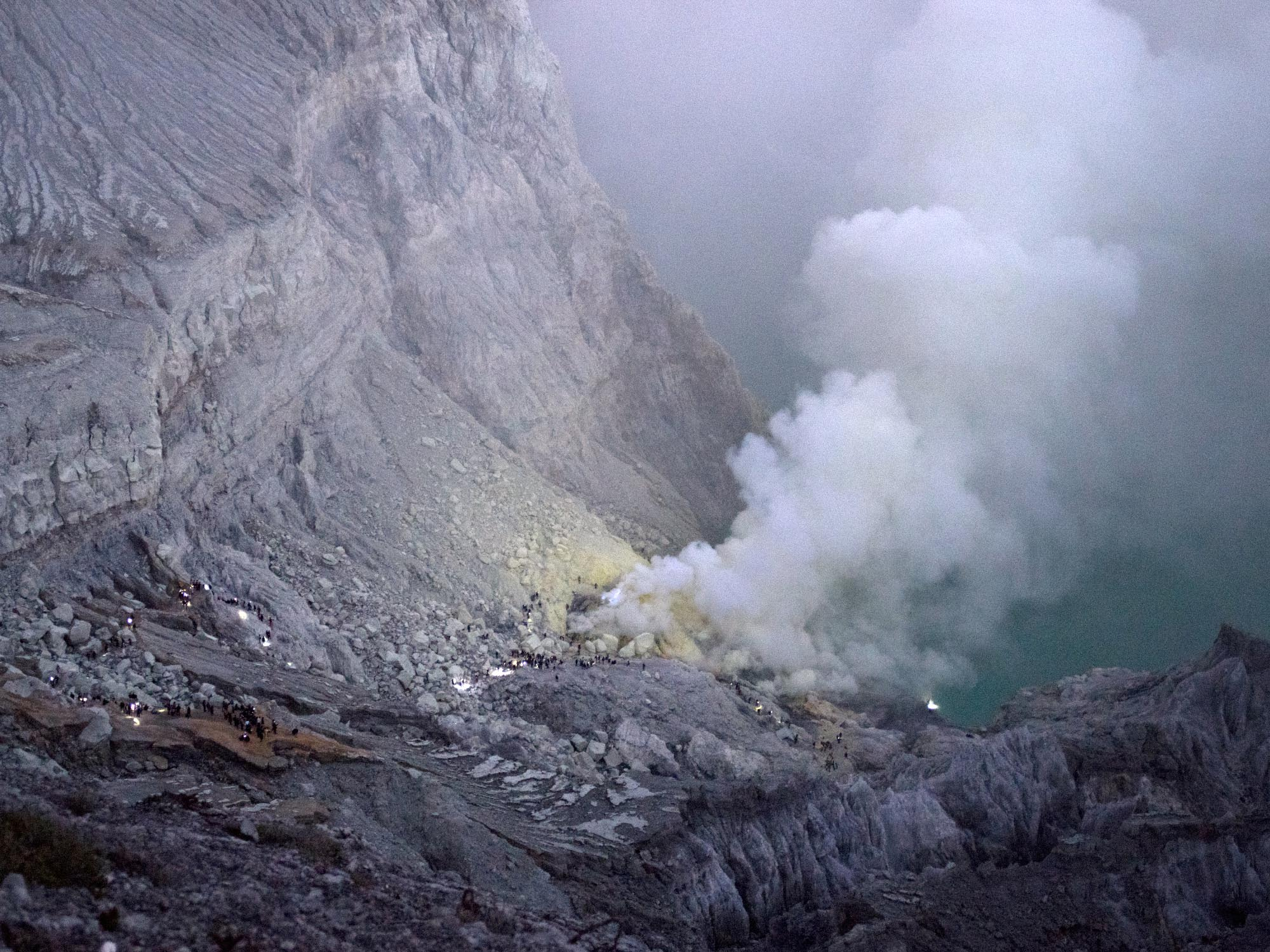 Ijen's crater before sunrise. Can you spot the faint blue flame?