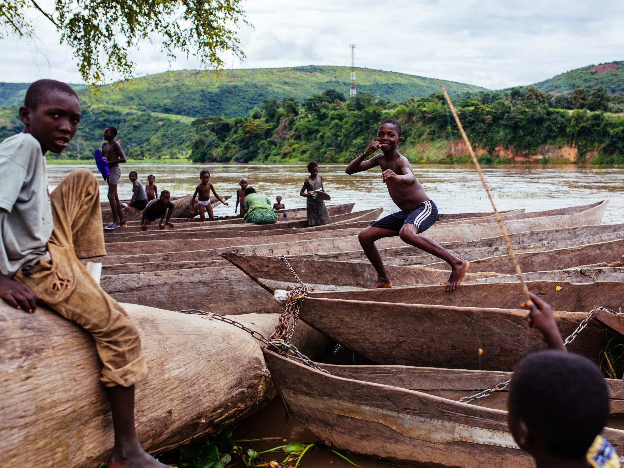 Kids playing on the banks of the Kenge River. Democratic Republic of Congo.
