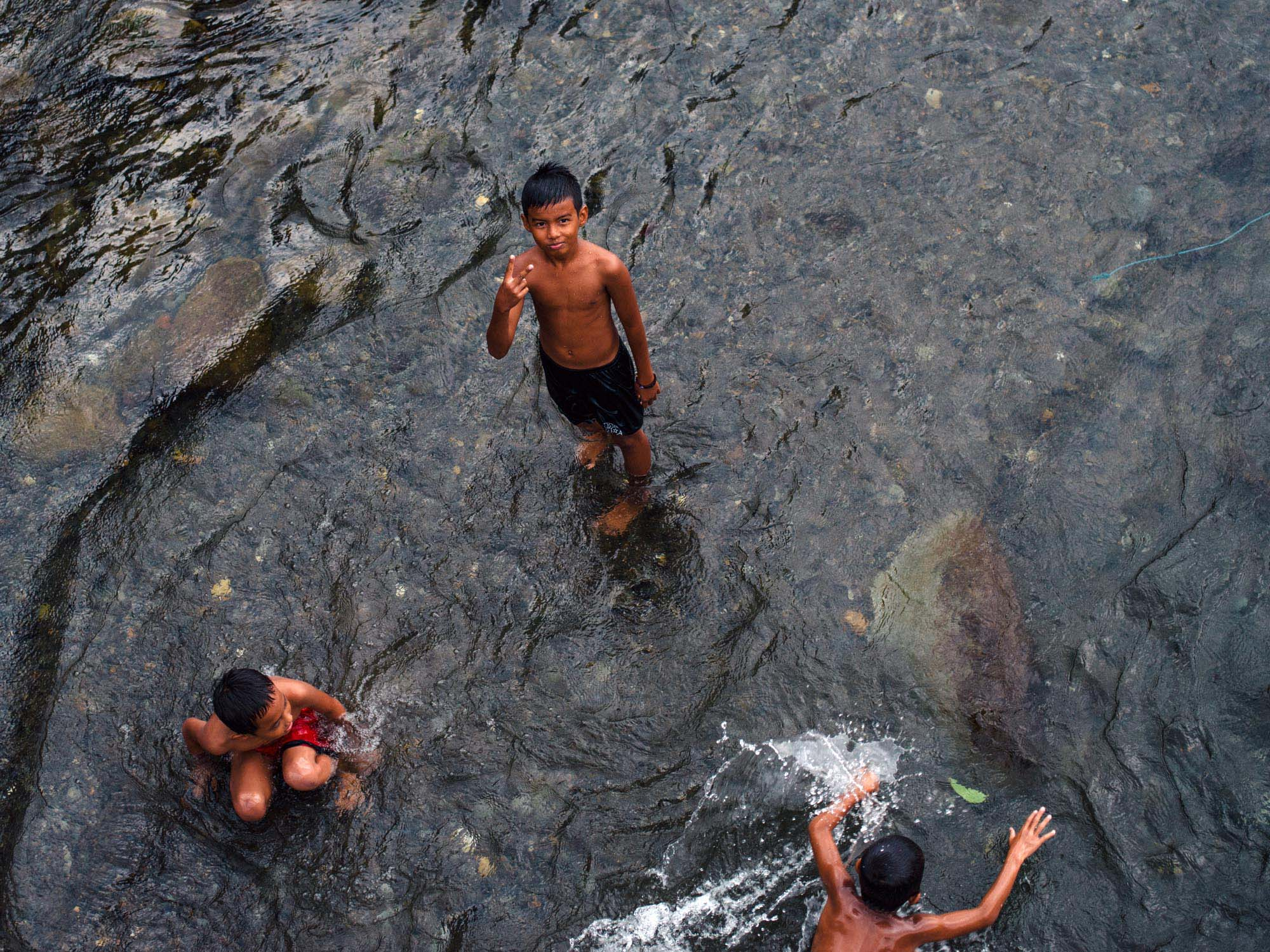 Kids playing in the river.