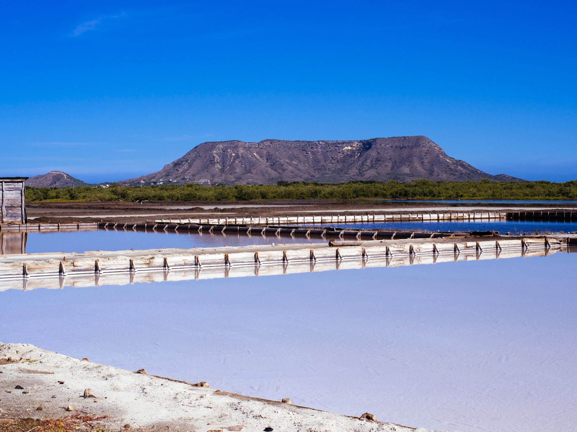 Salt mines in Montecristi with El Morro in the background.  All photography by Joris Hermans.