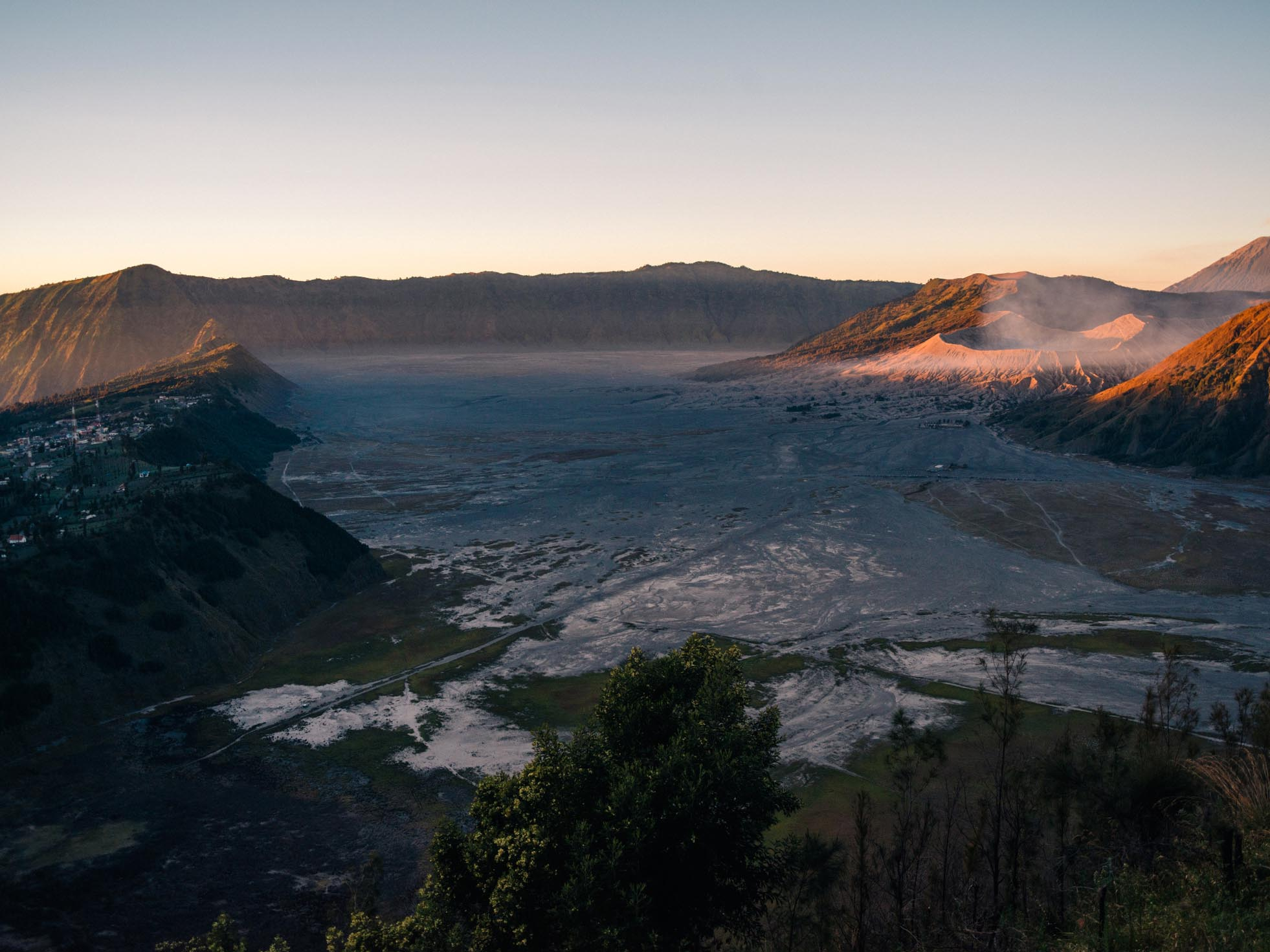 The main caldera and the Sea of Sand. The sun hits Mount Bromo on the right.