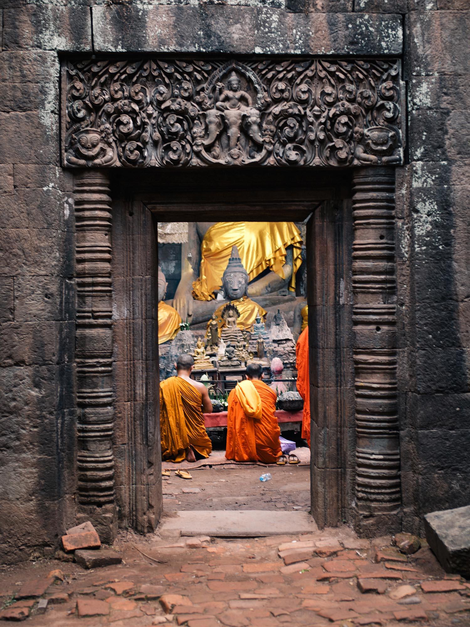 Monks praying in the shrine.