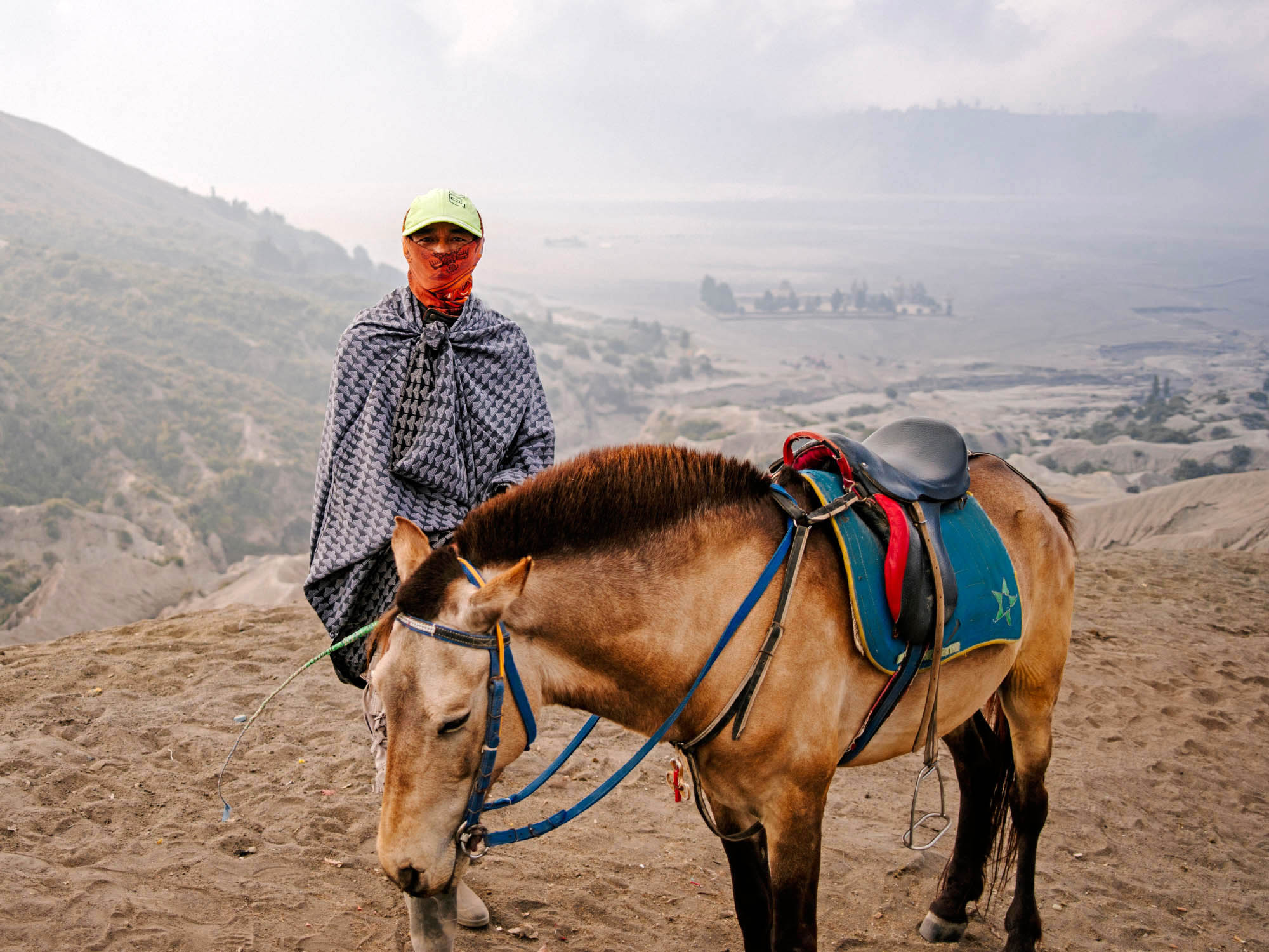 Man with horse on the slopes of Mount Bromo.