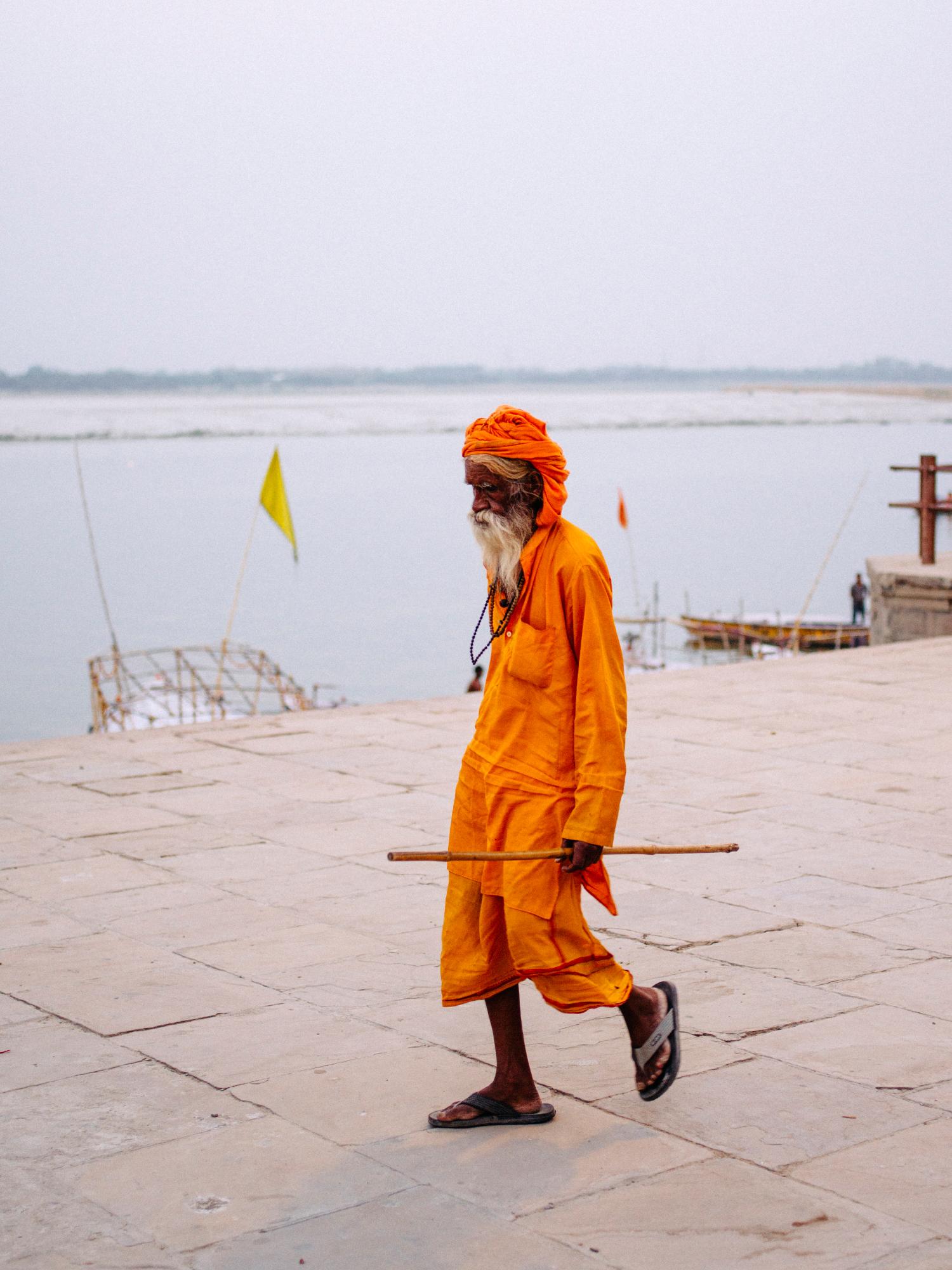 Holy man walking along the banks of the river Ganga.