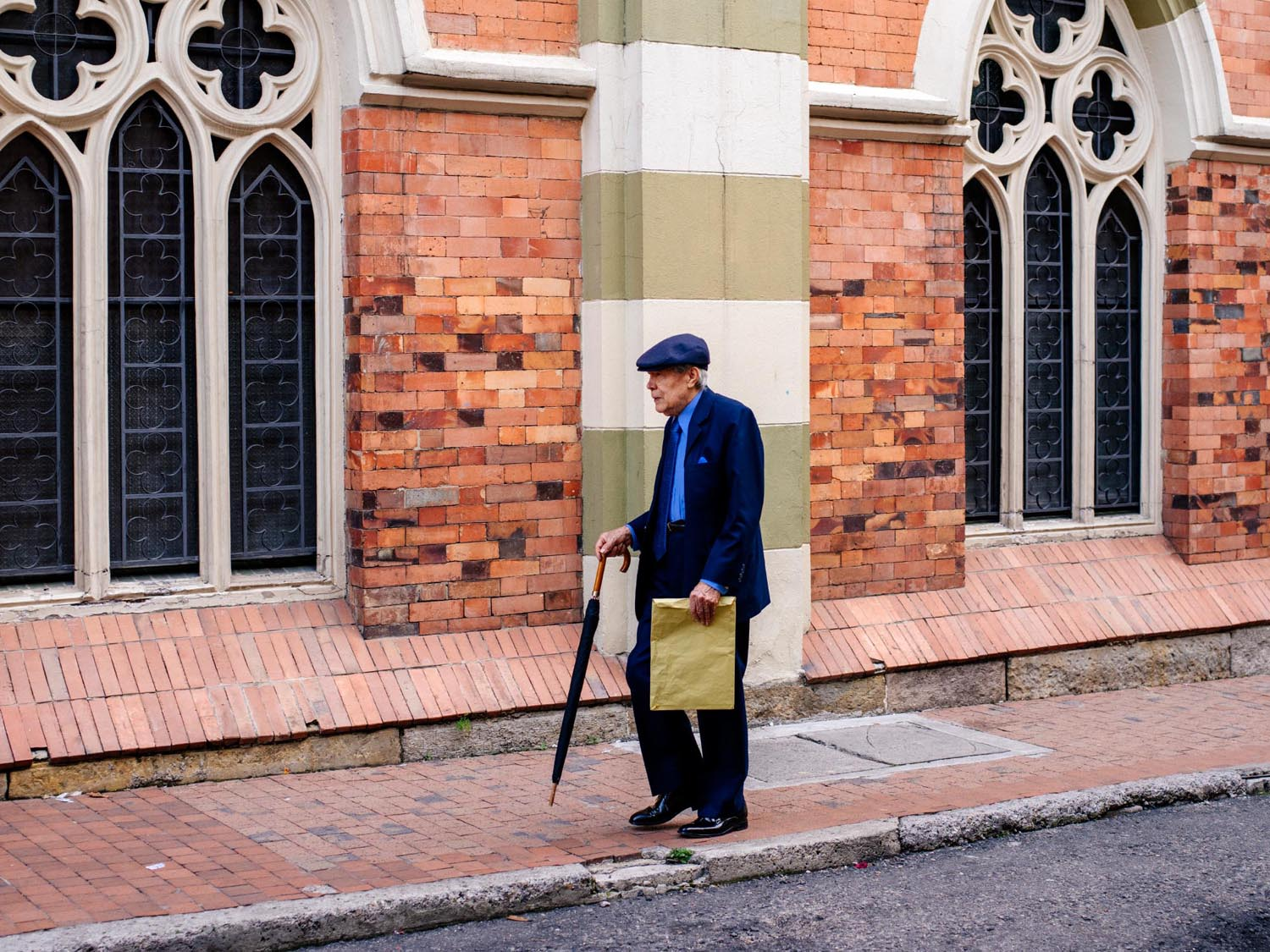 Man walking in front of a church in La Candelaria.