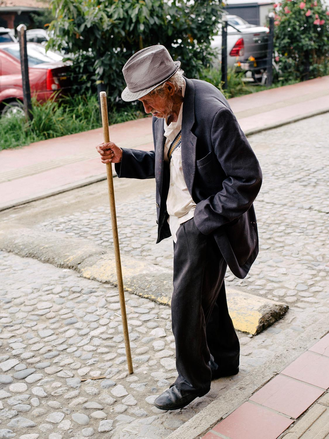 Old man strolling down the street.