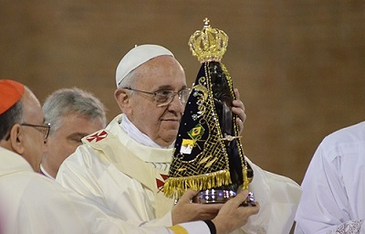 Pope_Francis_holds_a_Statue_of_Our_Lady_at_the_National_Shrine_of_Our_Lady_of_Aparecida_July_24_Credit_Ronaldo_Correa_via_JMJ_Rio_2013_Flickr_CC_BY_NC_SA_.jpg