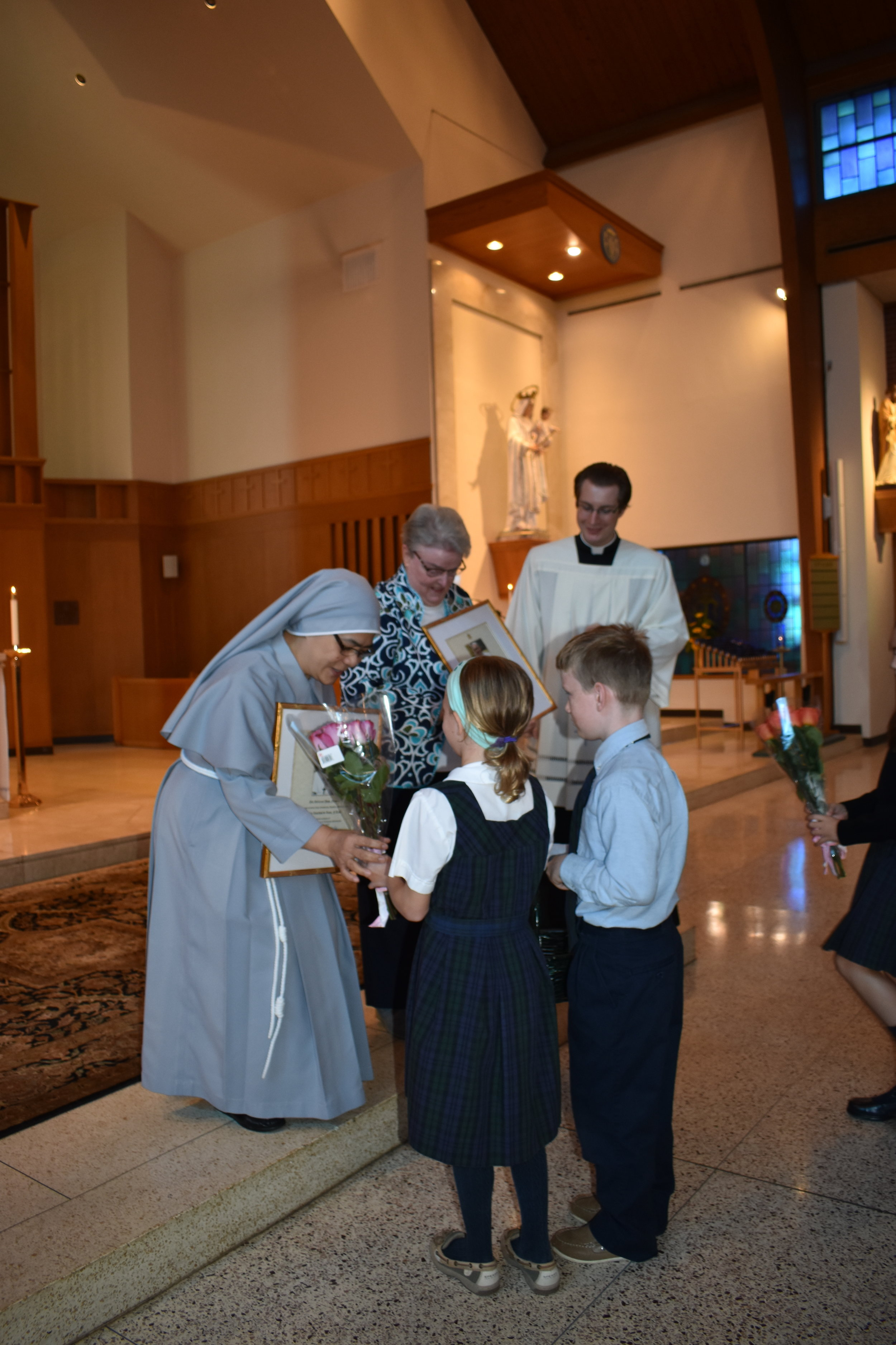 Sister Jeanne Barry, RSM and Sister Lourdes DeLeon, FAS are congratulated by the OLM School children on their annivesaries of relgious profession.