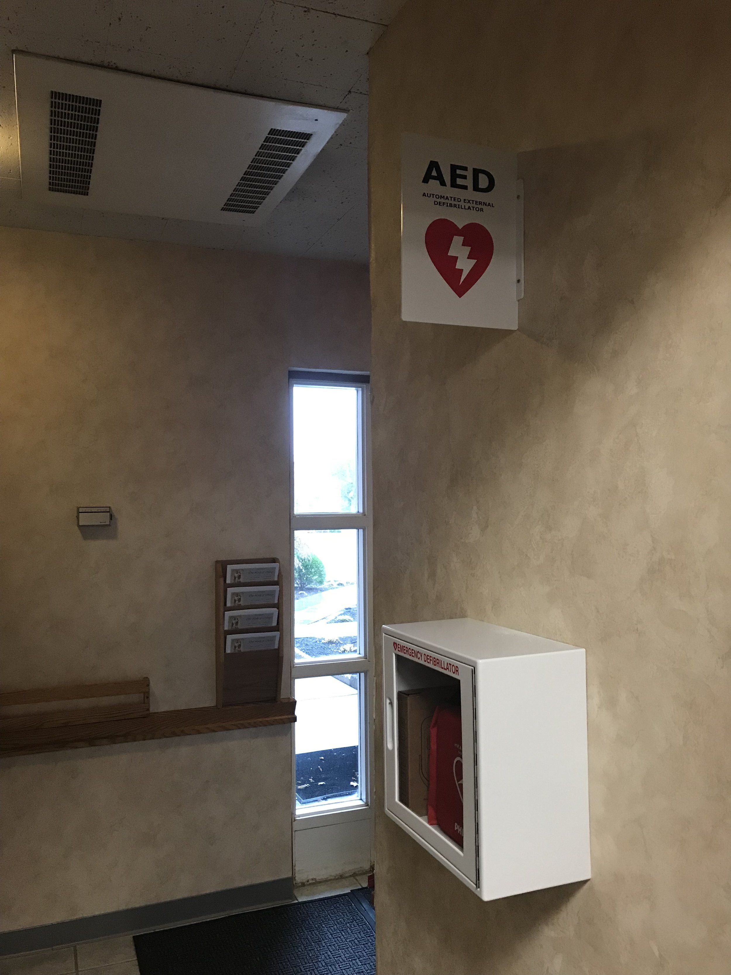 New AED by the OLM Sacristry Door.