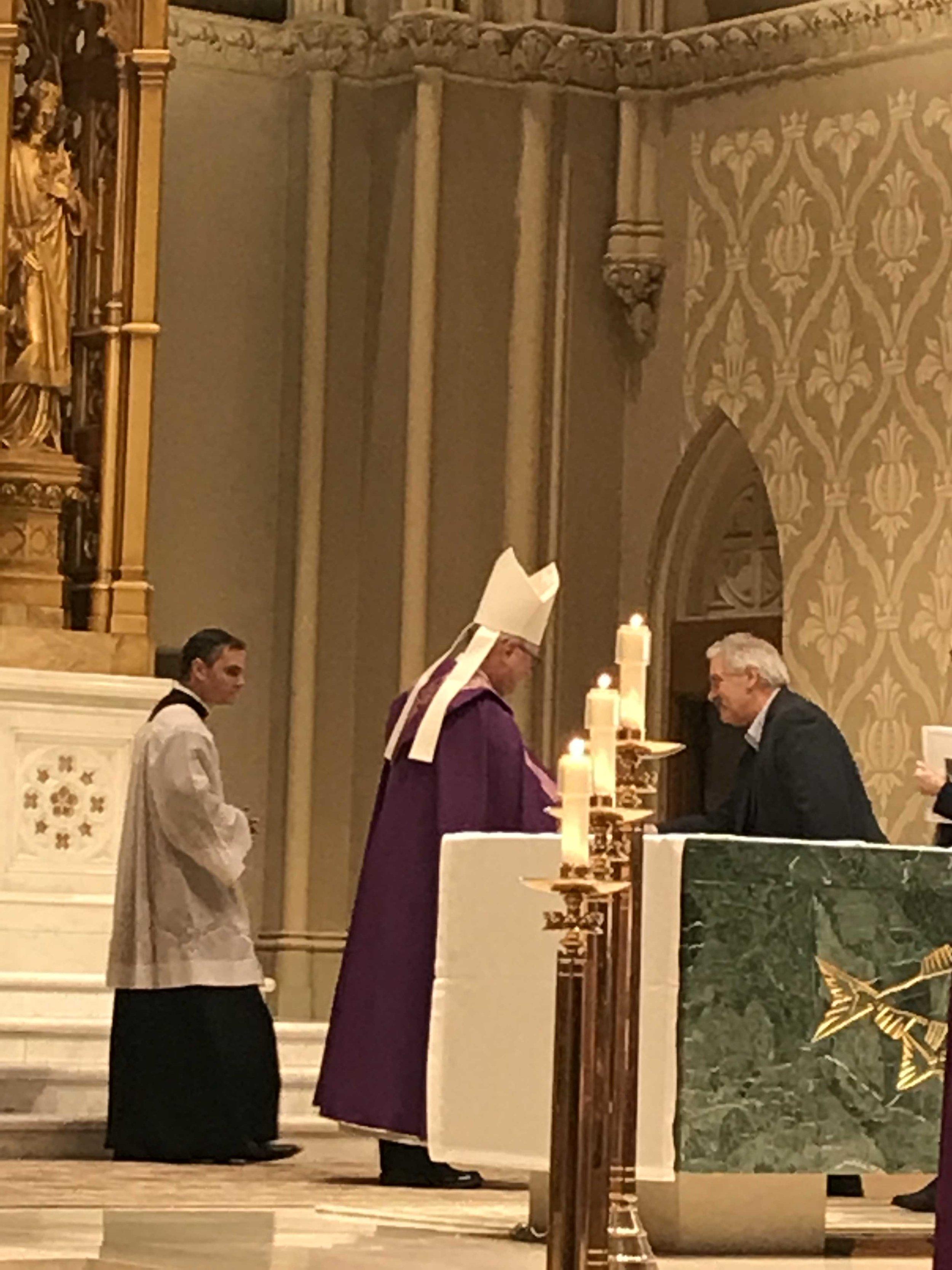 Bishop Tobin greets Al Behbehani.