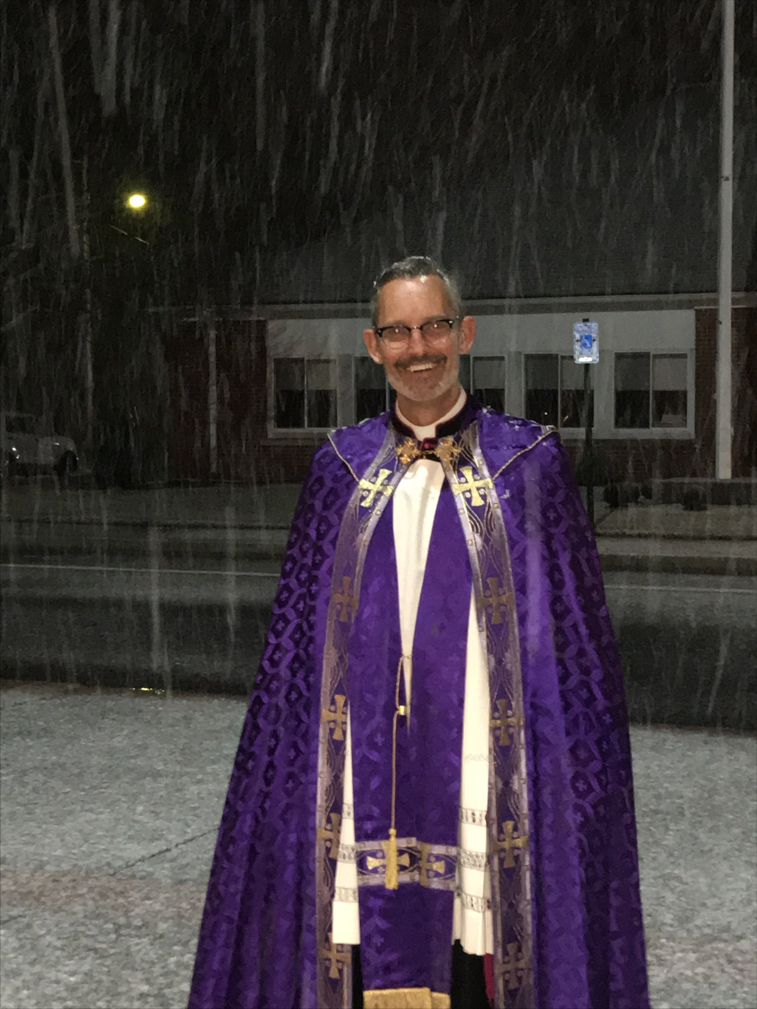 Monsignor Cook enjoys the New England weather on the last night of the Mission!