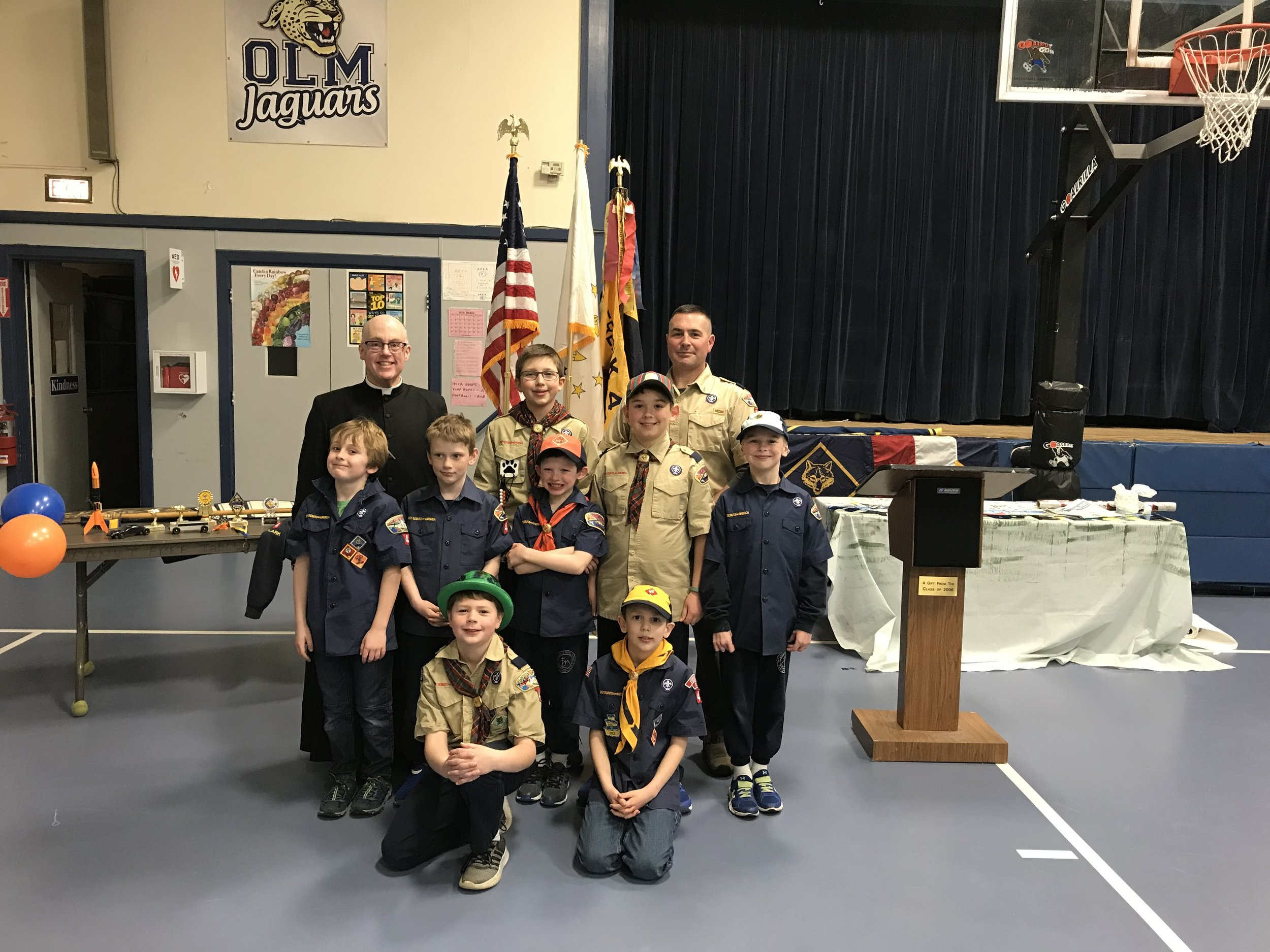 Fr. Healey celebrates with the scouts from OLM School.