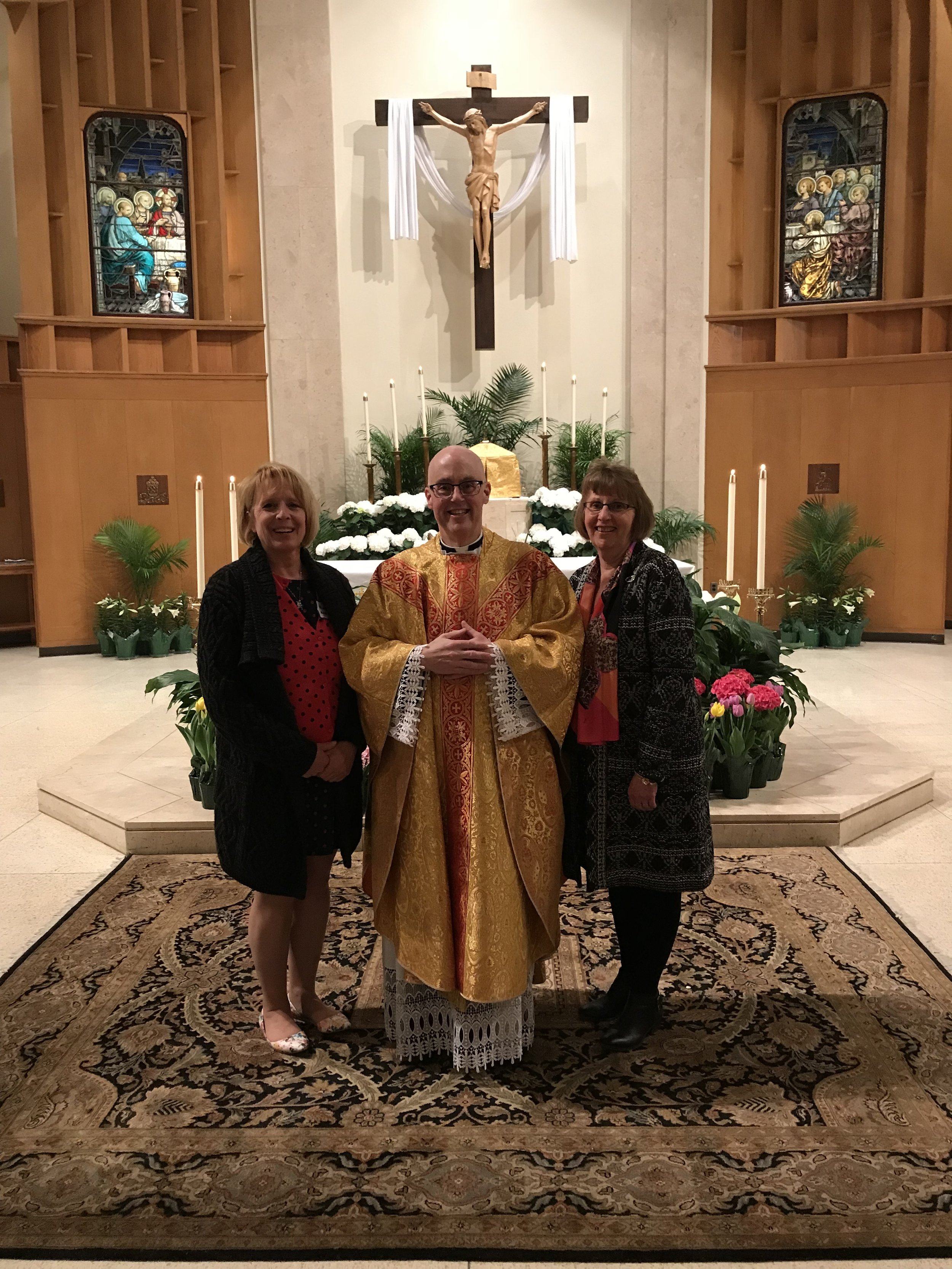 Newly recieved into the Catholic Church at the Easter Vigil on March 31st, Sue Healey poses with Fr. Healey, OLM Pastor and Janice M. Healey, her sponsor.