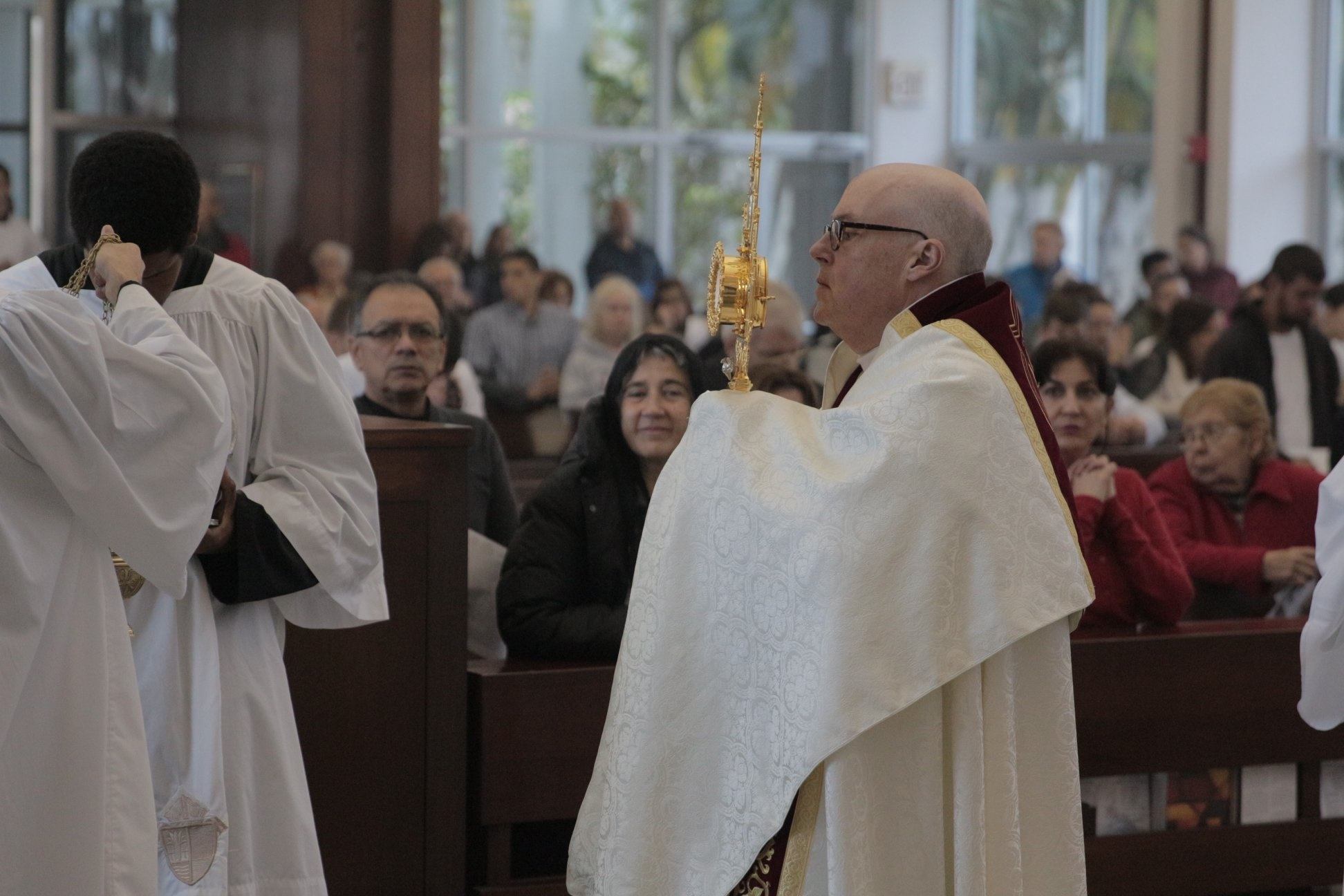 Father Healey leads a Eucharistic Procession.