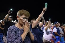 Catholics gather in prayer in El Paso following the tragic shootings at Walmart.