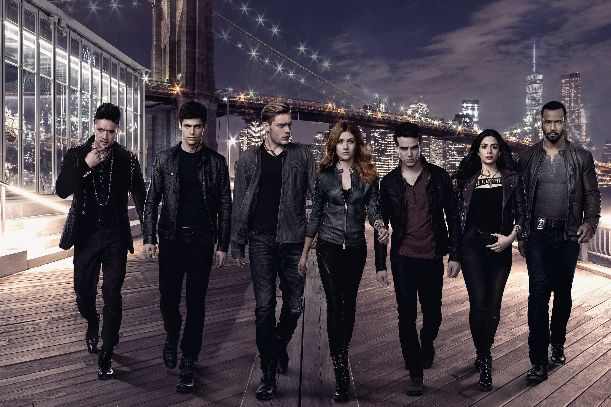 Left to right: Magnus Bane, Alec Lightwood, Jace Wayland, Clary Fray, Simon Lewis, Isabelle Lightwood, and Luke Garroway